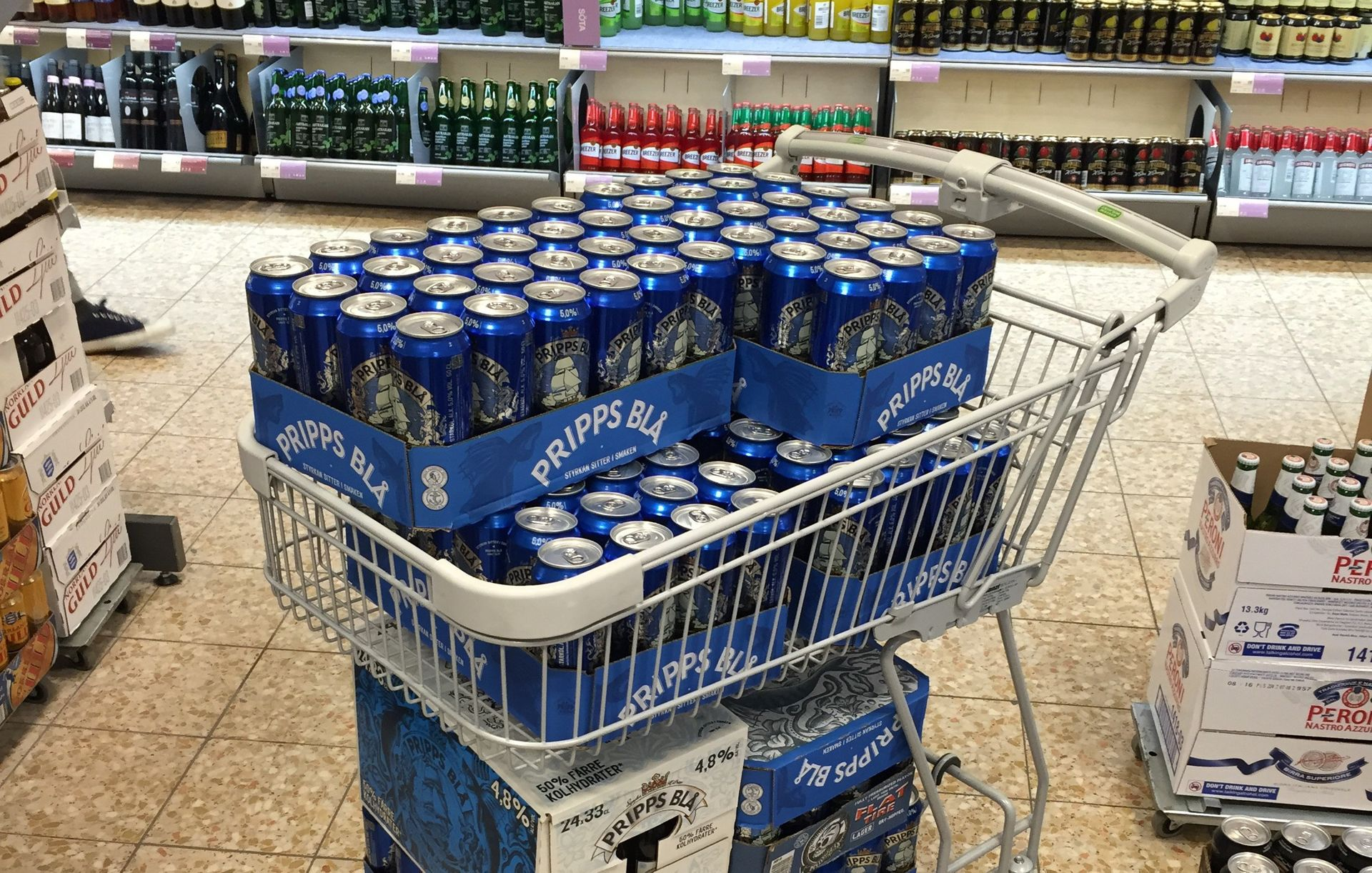 Trolley full of beer cans.