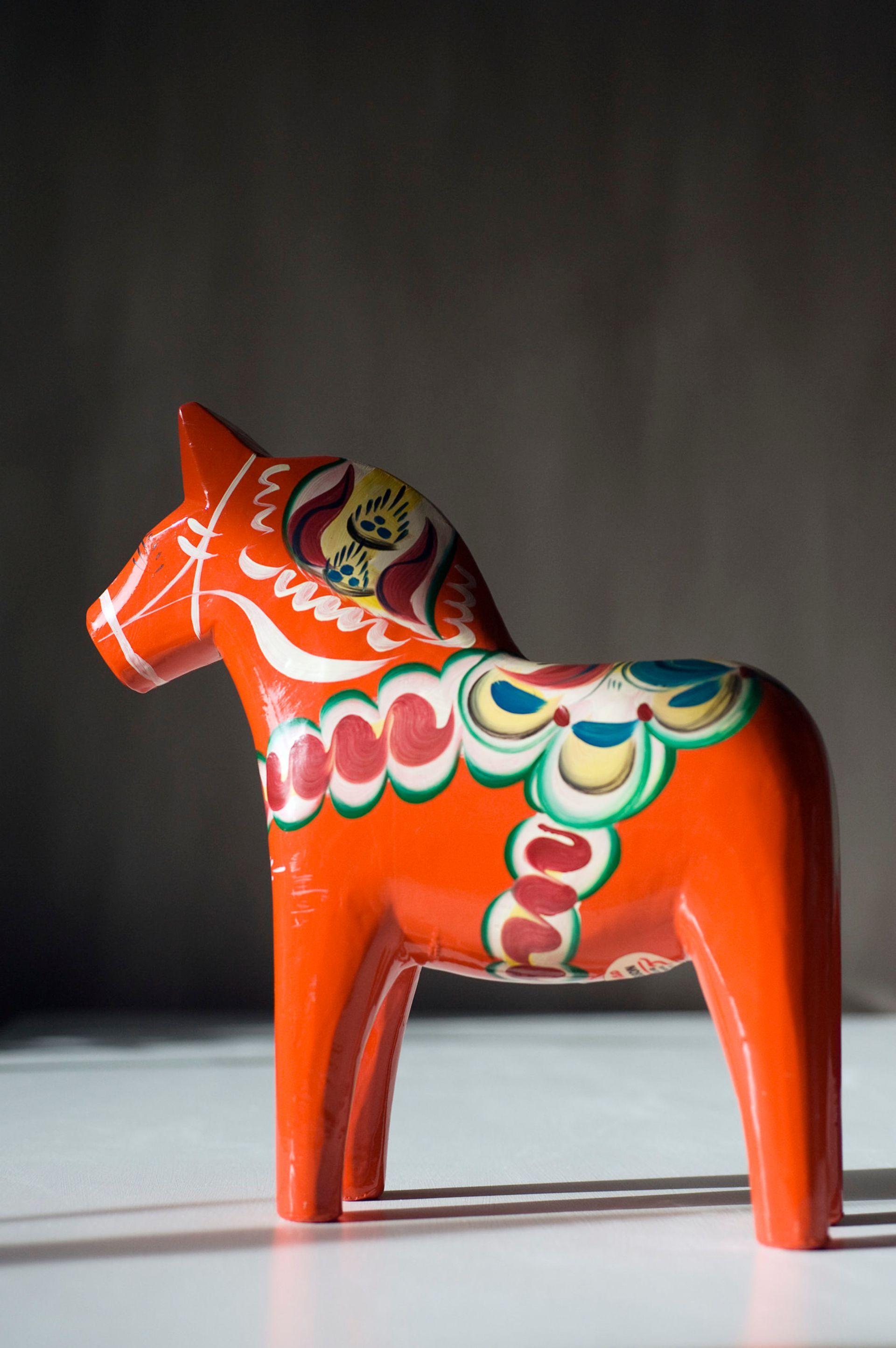Close up of a red Dala horse.