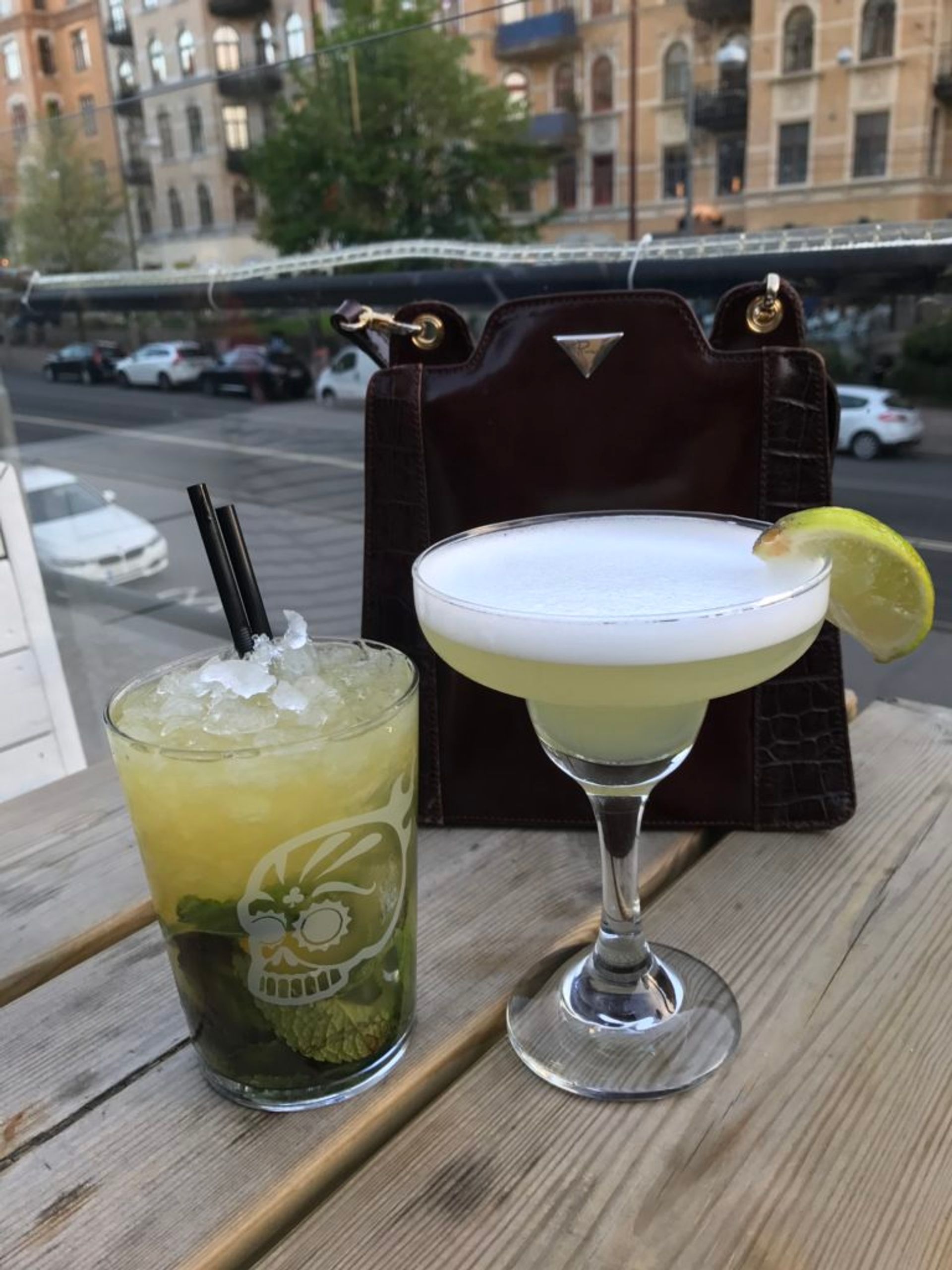 Two cocktail drinks on a table.
