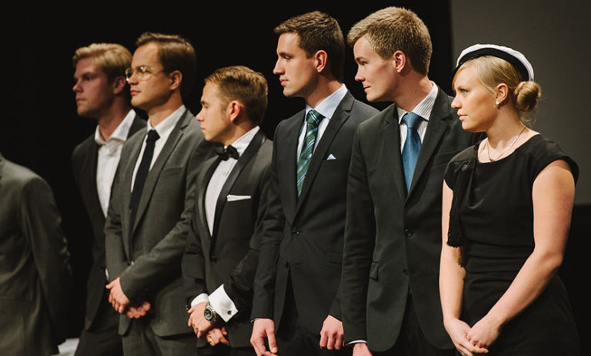 Students dressed up in suits.