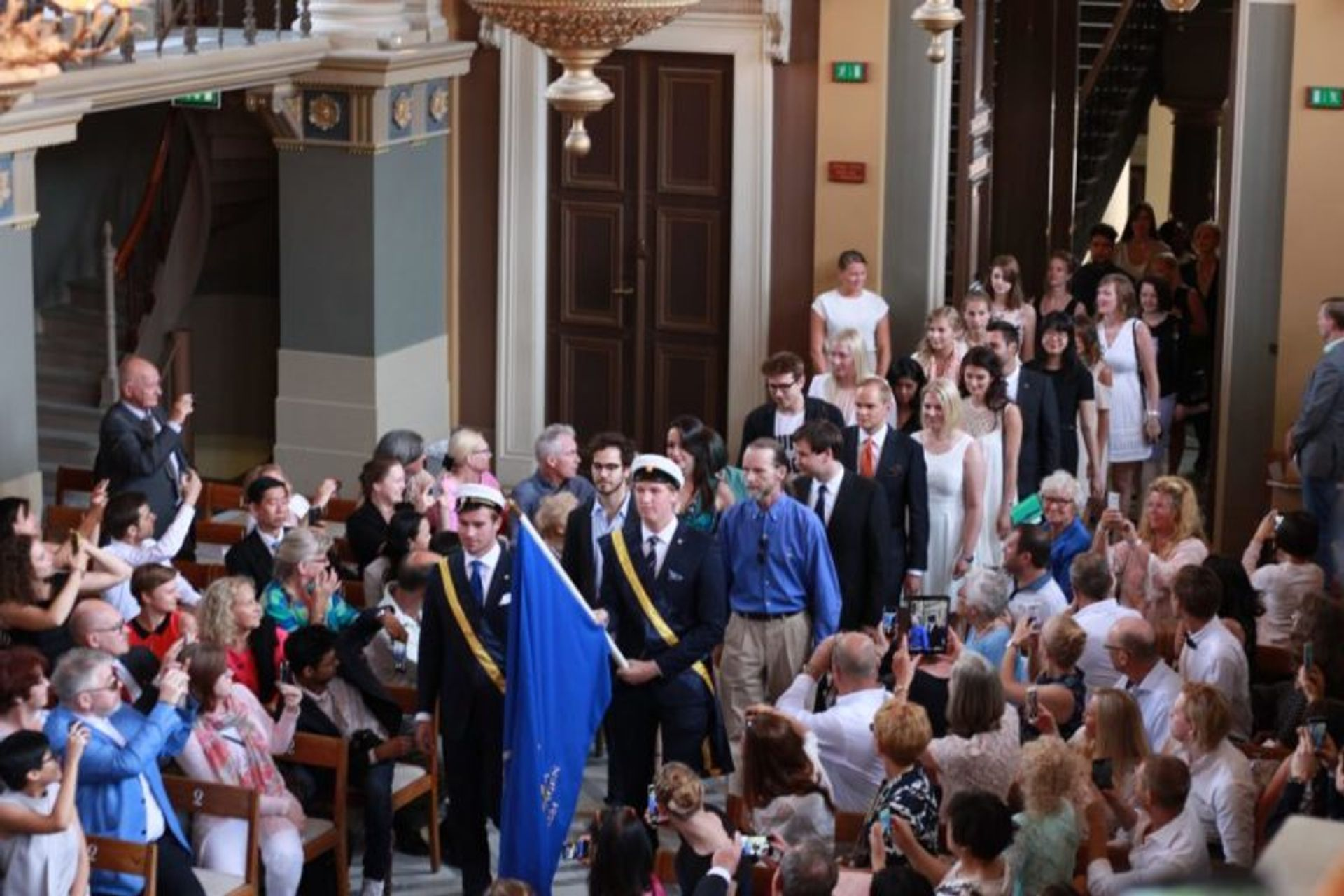 Students at a graduation ceremony.