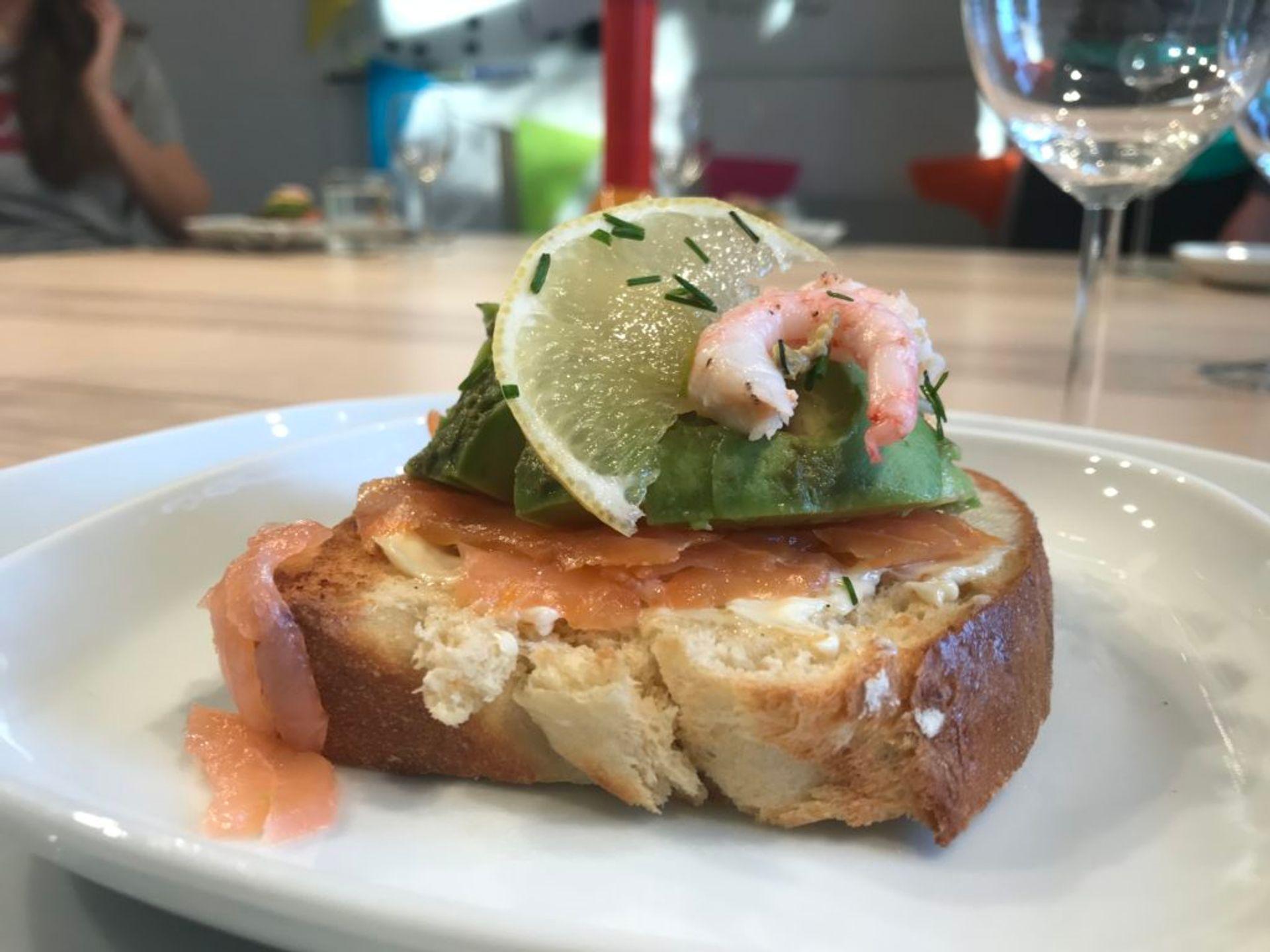 a photo of salmon avocado toast