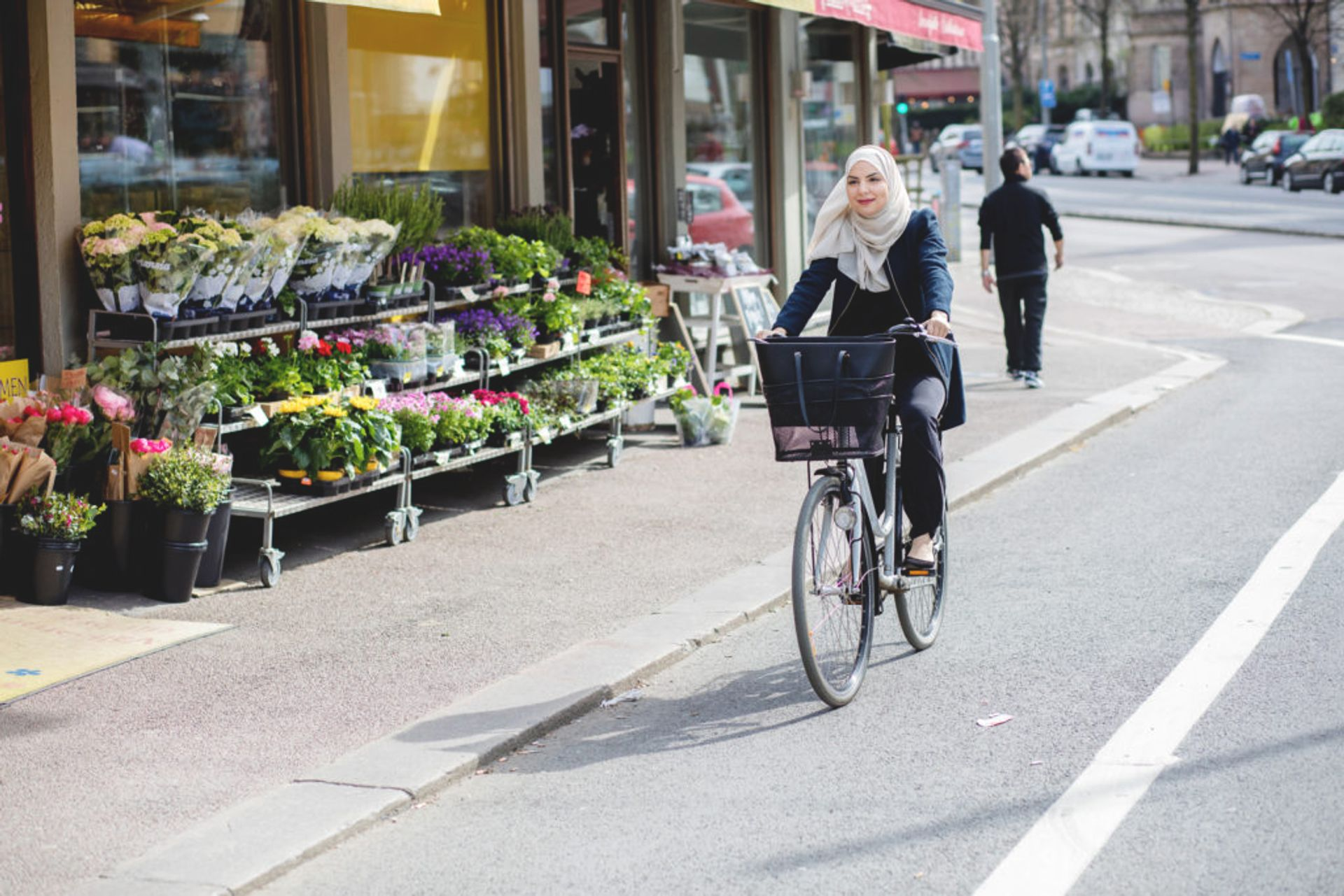 Person cycling in a bicycle lane.