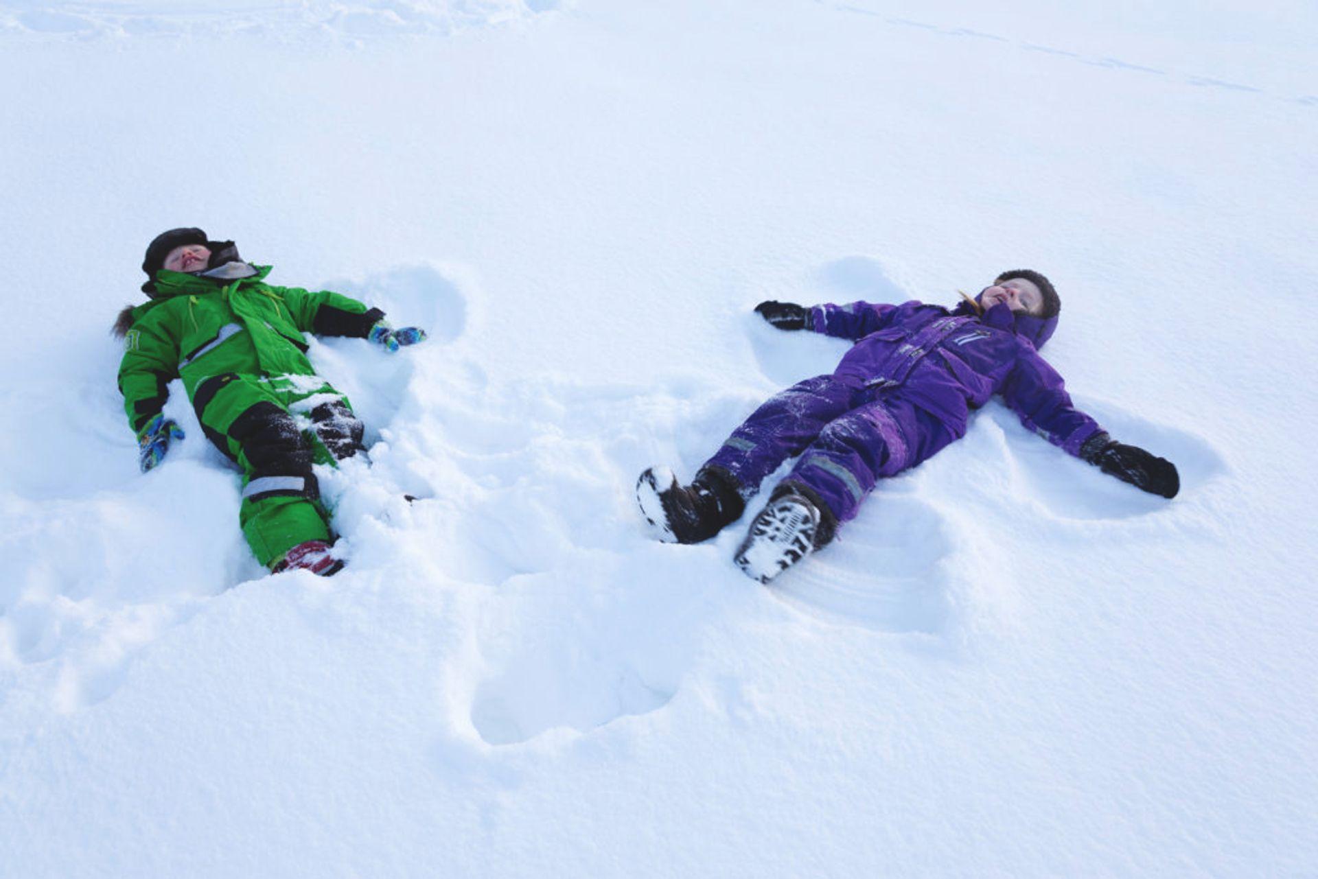 Children making snow angels.