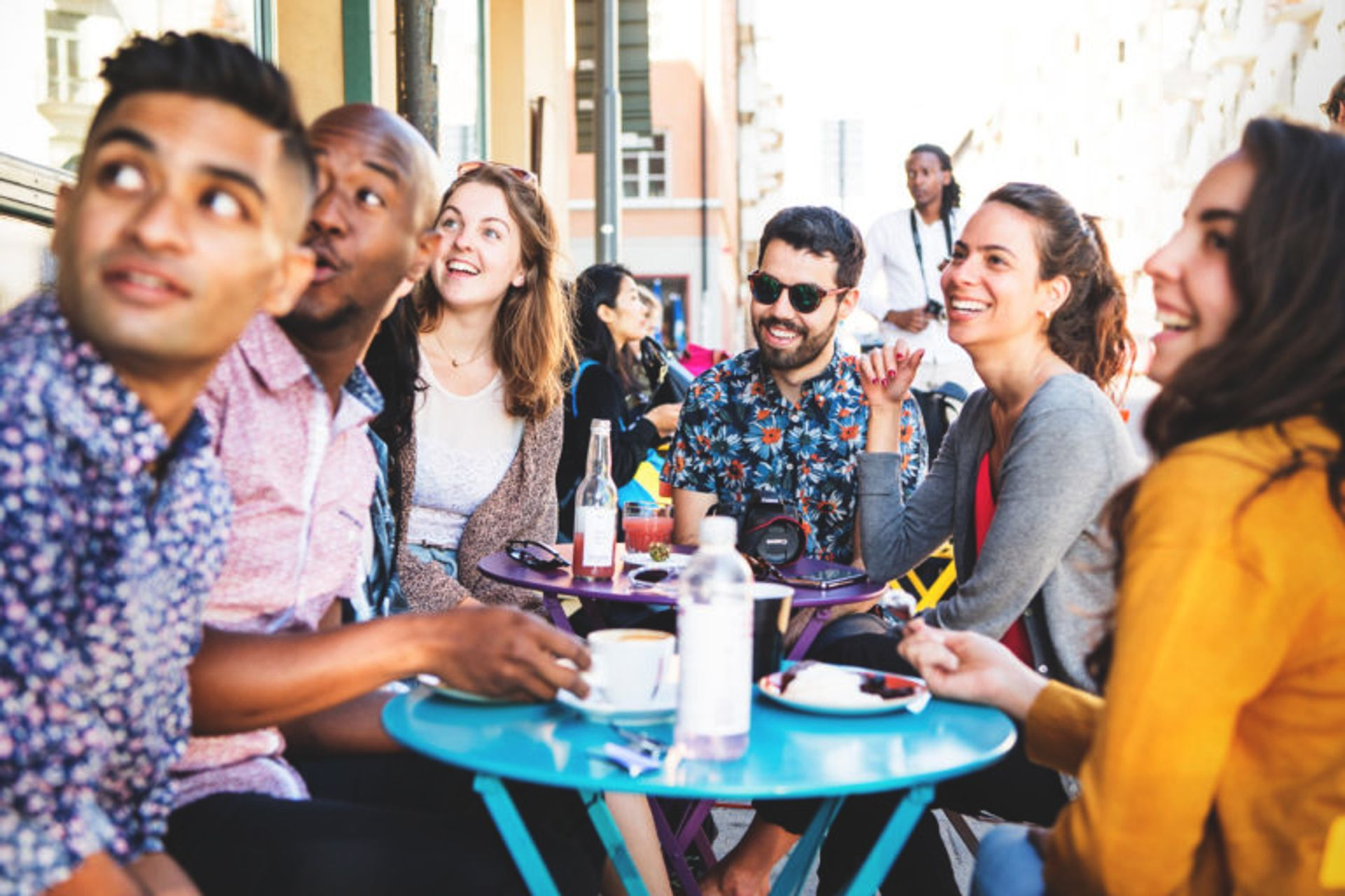 Students having fika at an outdoors cafe.