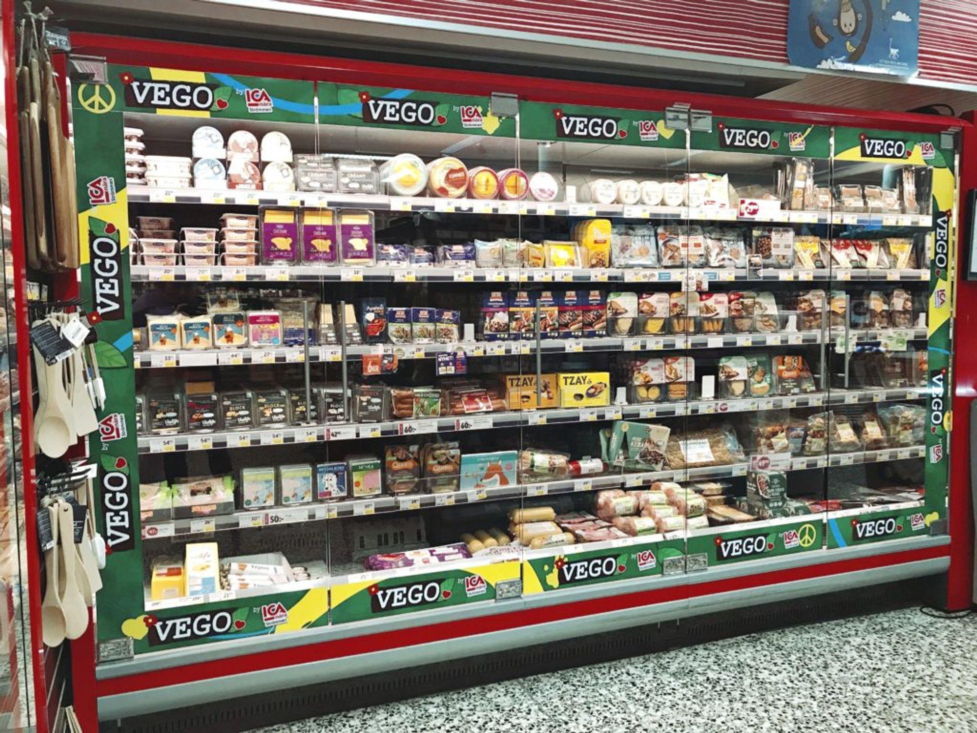 Shelves of frozen vegetarian food in a supermarket.