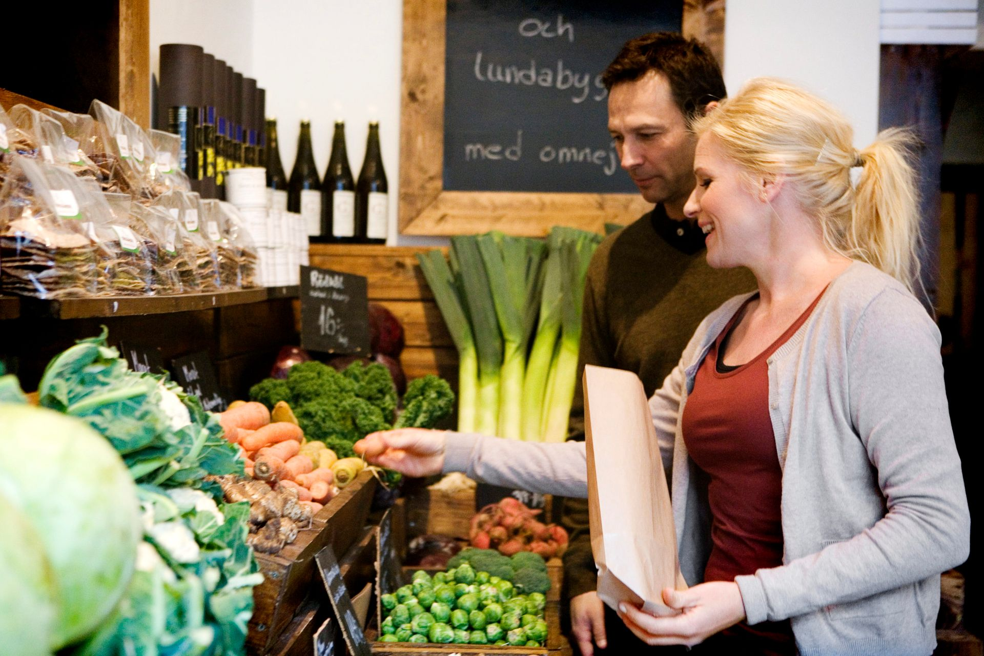 Two people shopping for vegetables.