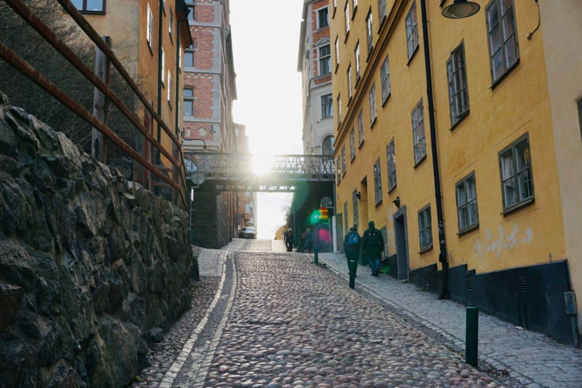 People walking along a cobbled stree.