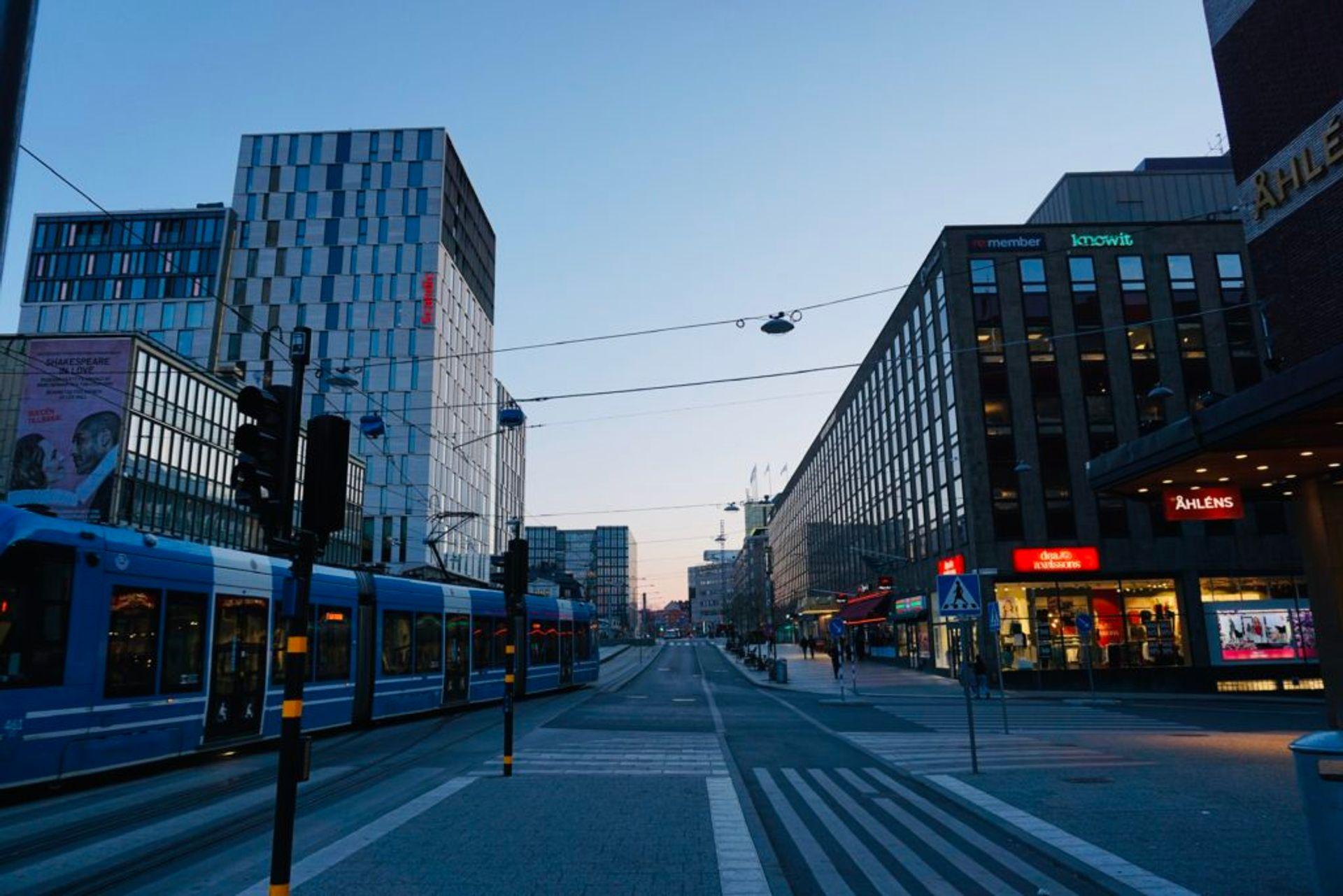 A tram on an empty street.