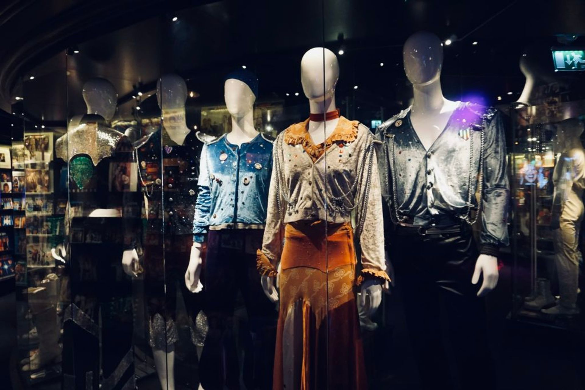 ABBA costumes in a exhibition cabinet.
