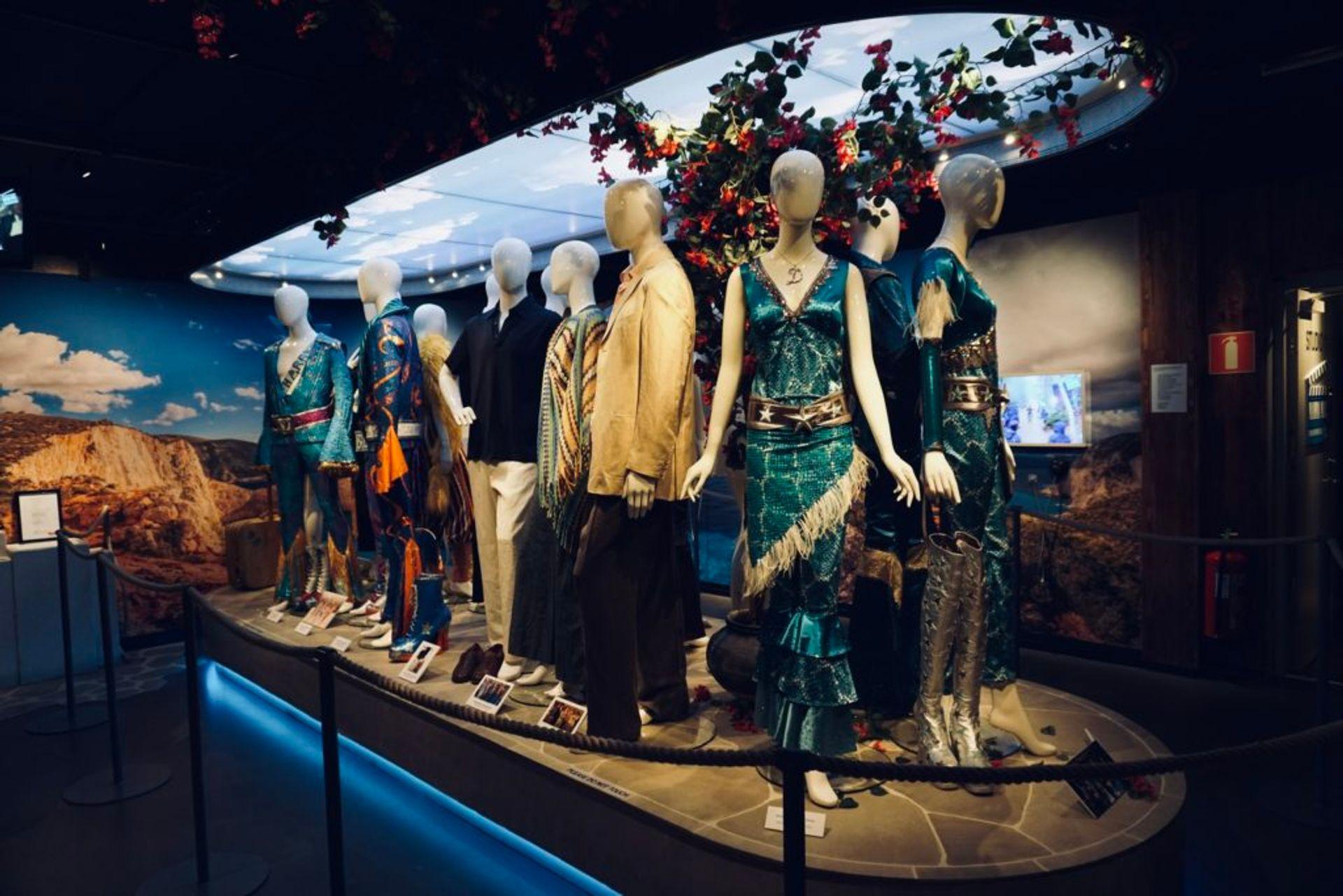 Mamma Mia costumes in an exhibition.