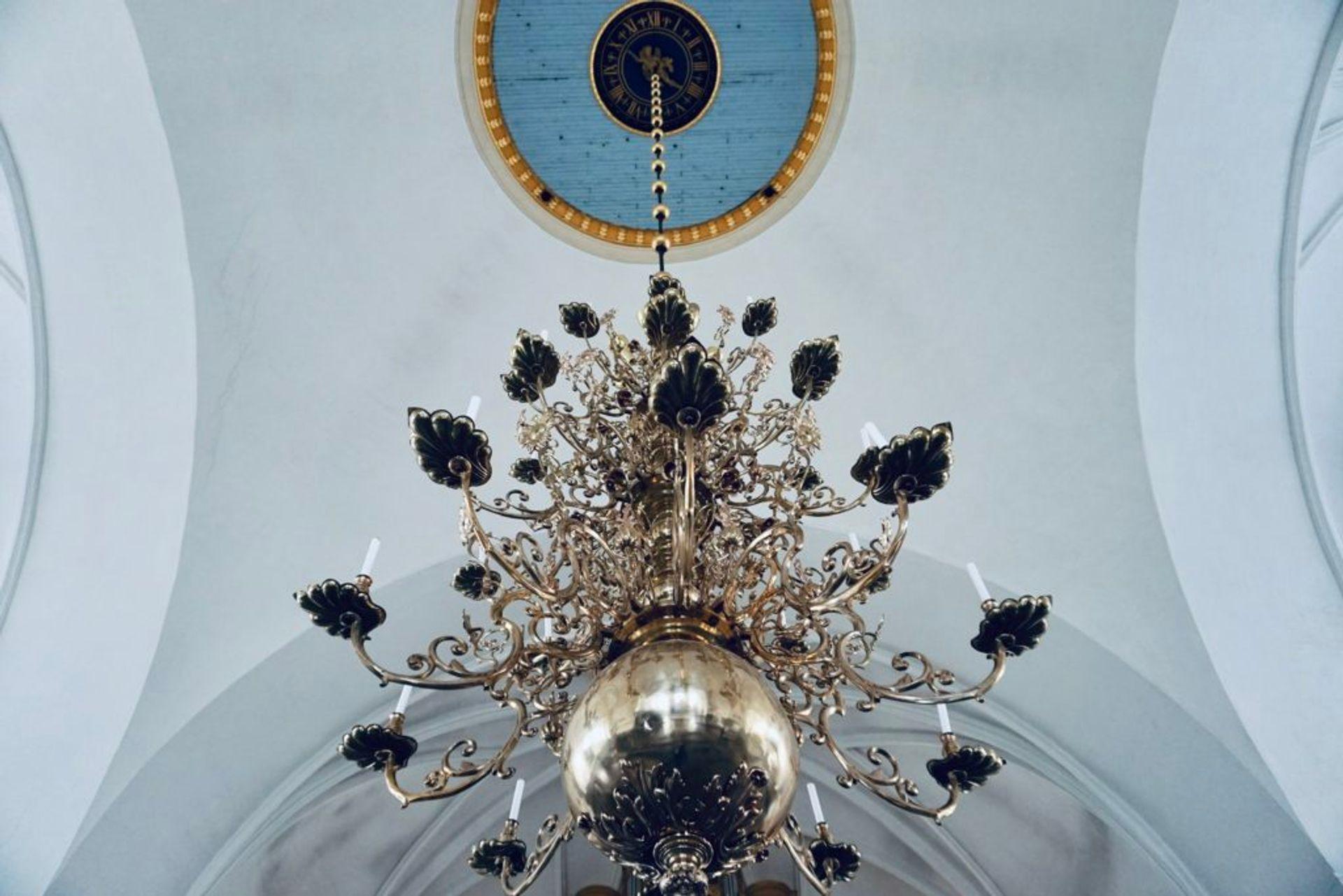 A chandalier in a church.