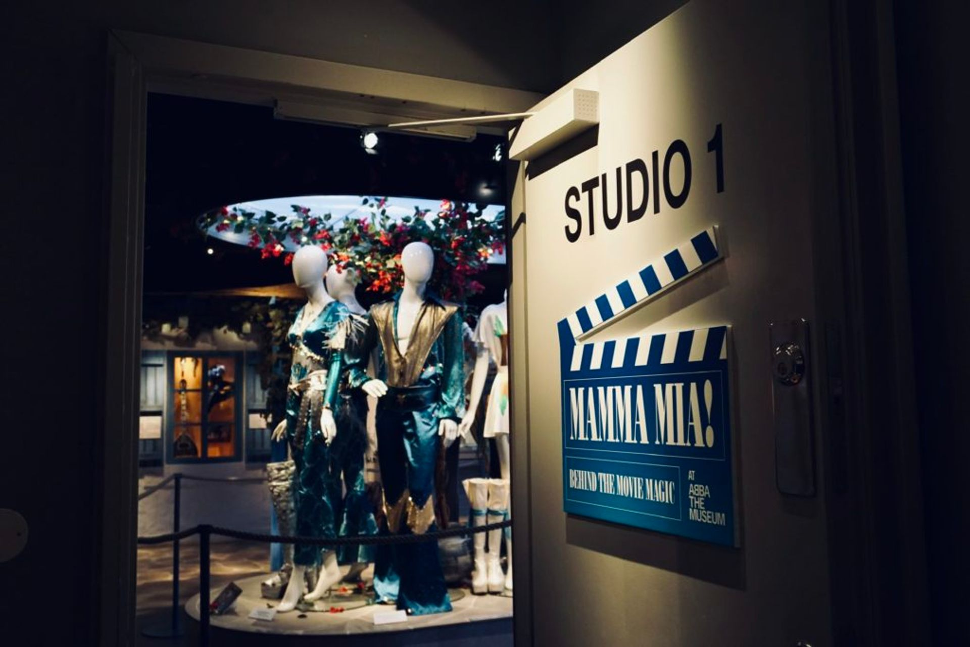 Mannequins dressed in Abba costumes at an exhibition.