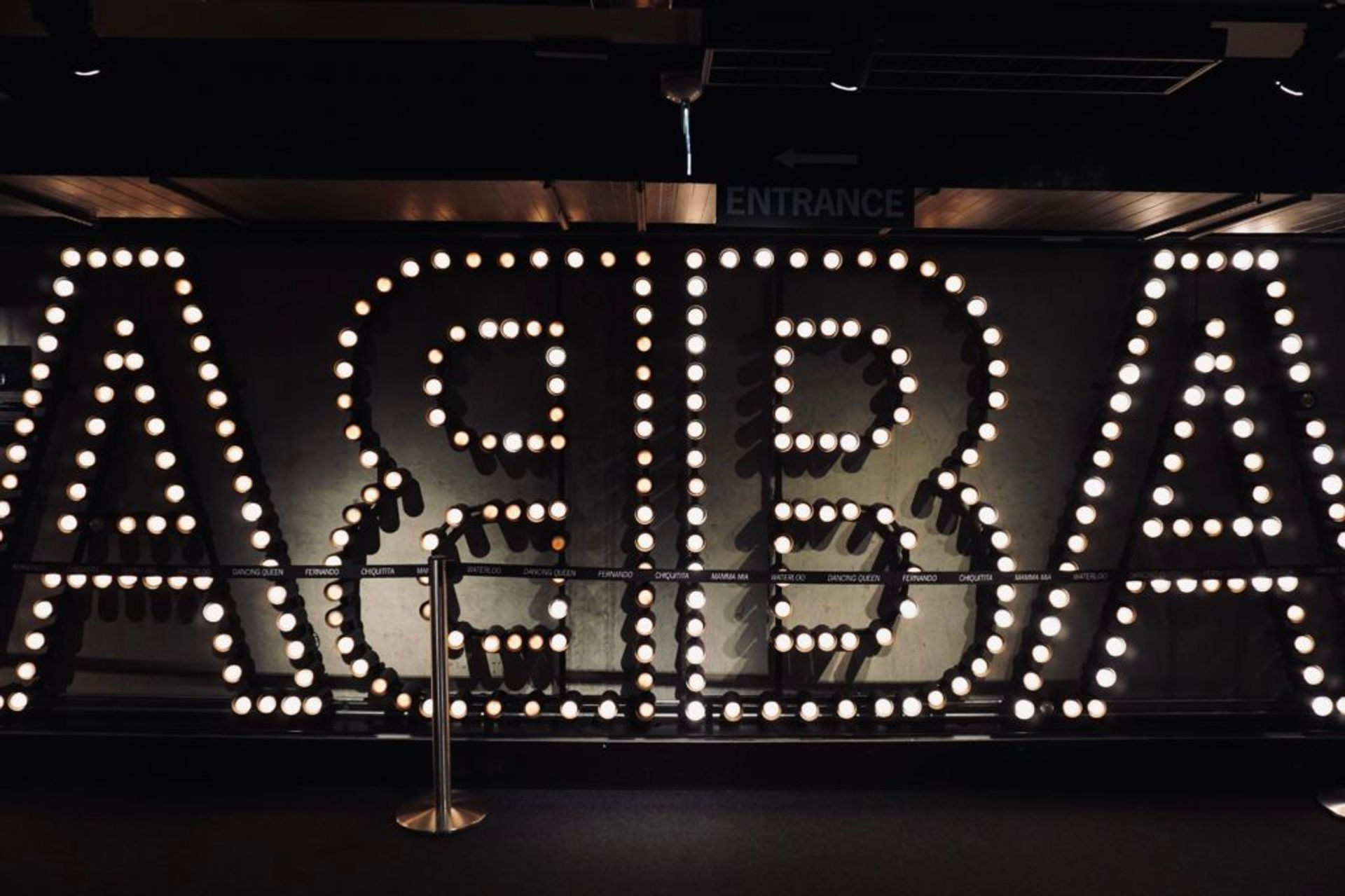 Lightbulbs on a wall spelling 'ABBA'