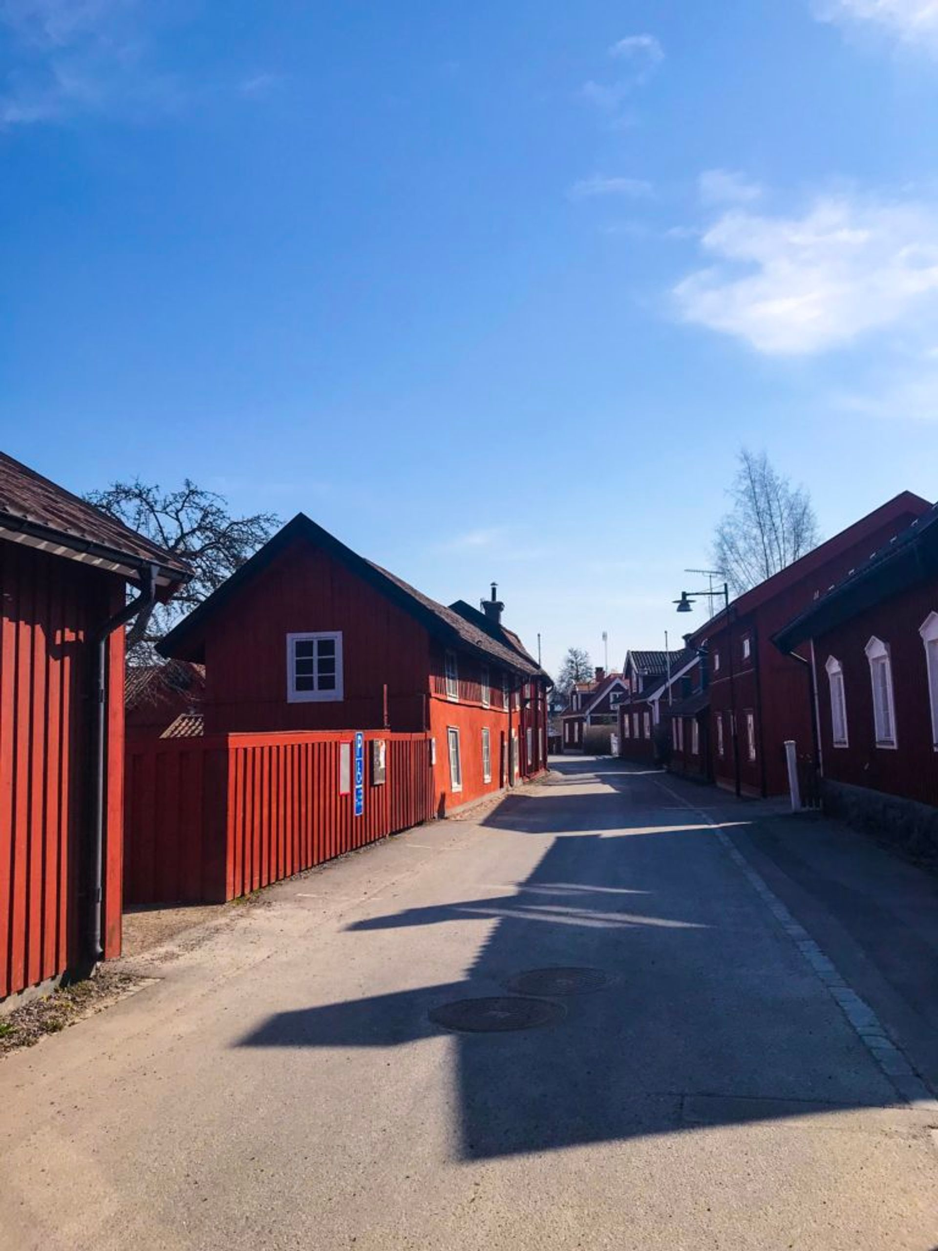 Wooden buildings painted in a dark red colour.