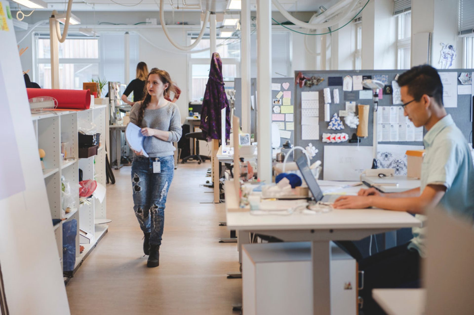 Students walking around a design studio.