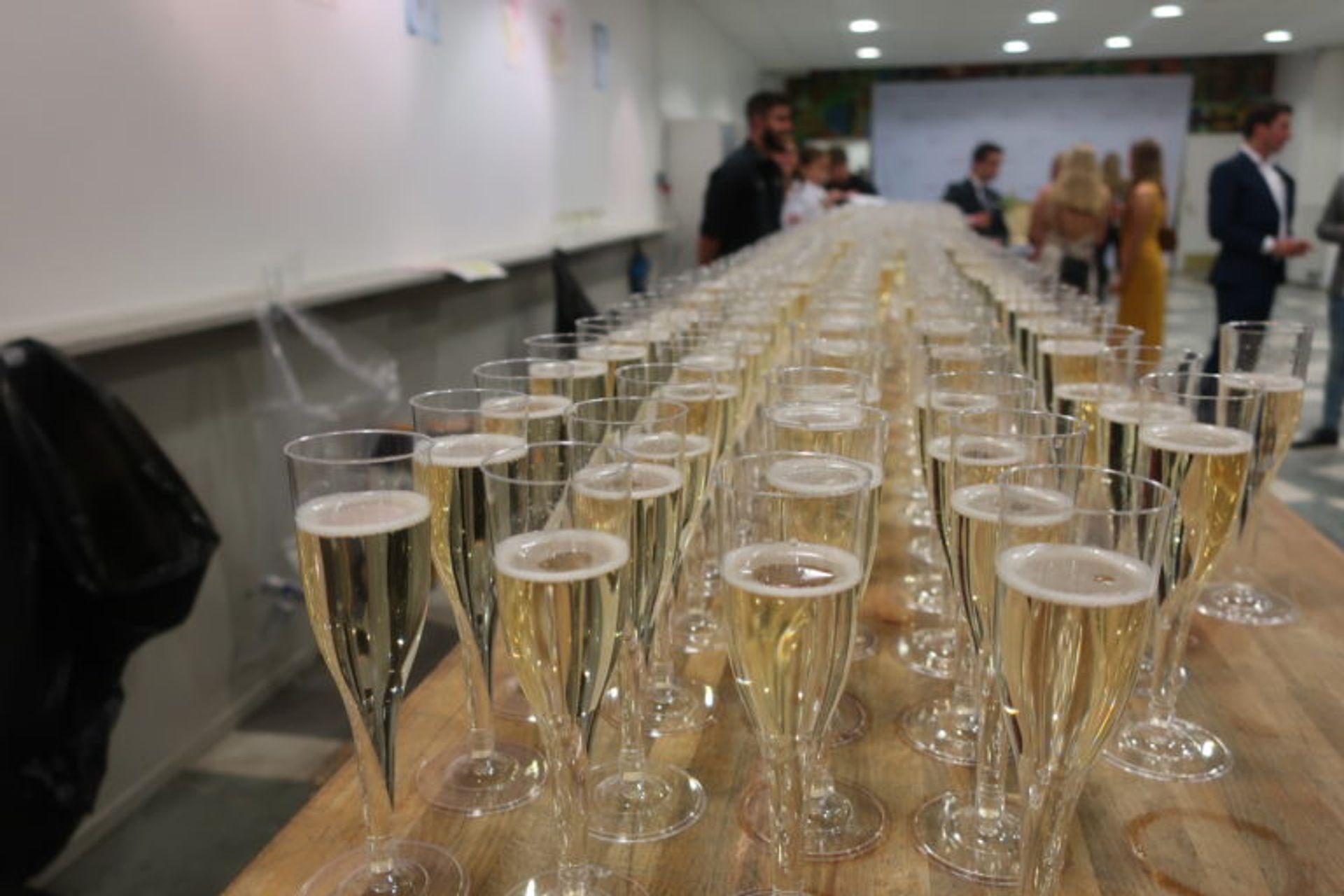 Close-up of hundreds of glasses of champange.