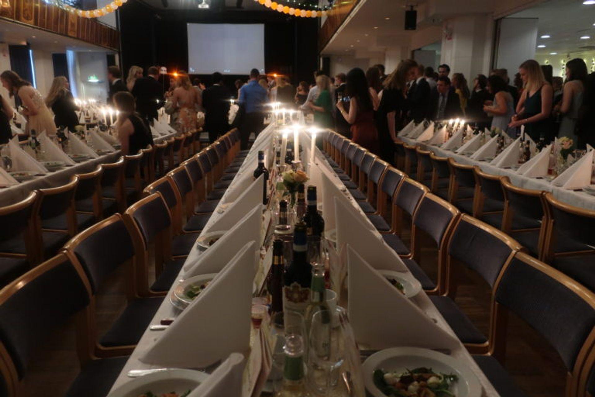 Rows of seats at a long table.