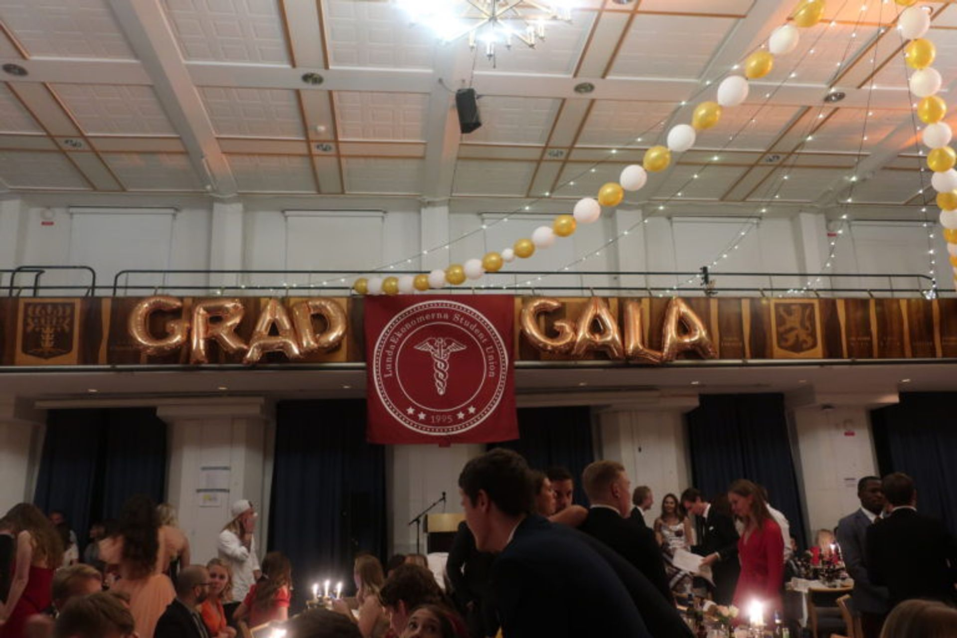 A large hall full of graduating students.