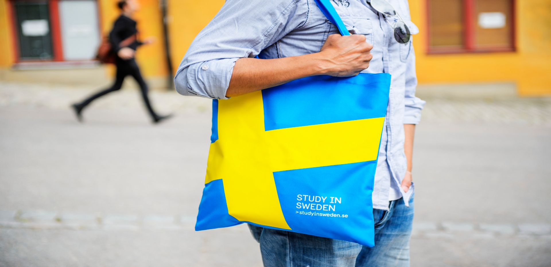 Close-up of a tote bag with the Swedish flag on it.