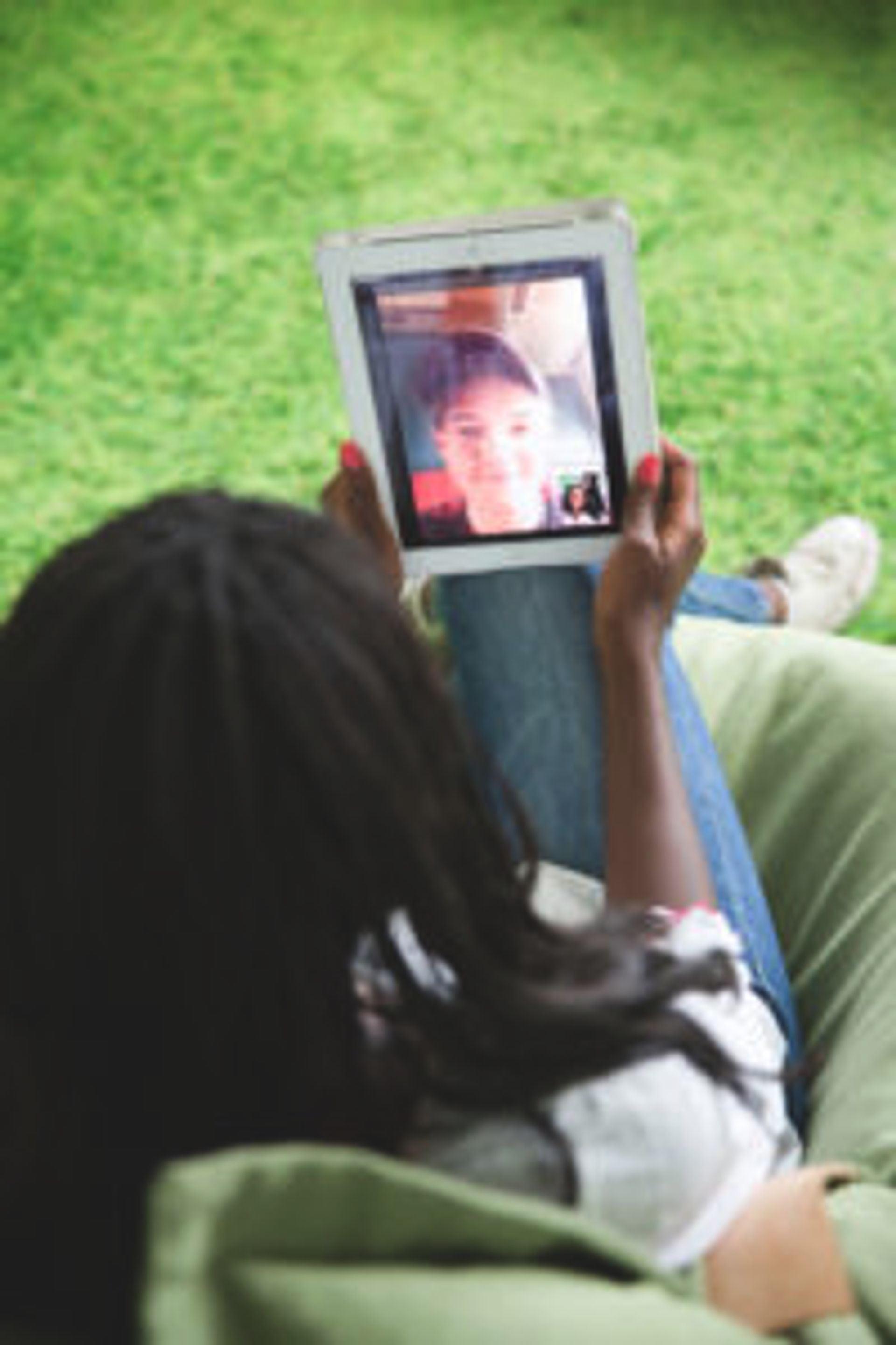 Person having a video call on an iPad.
