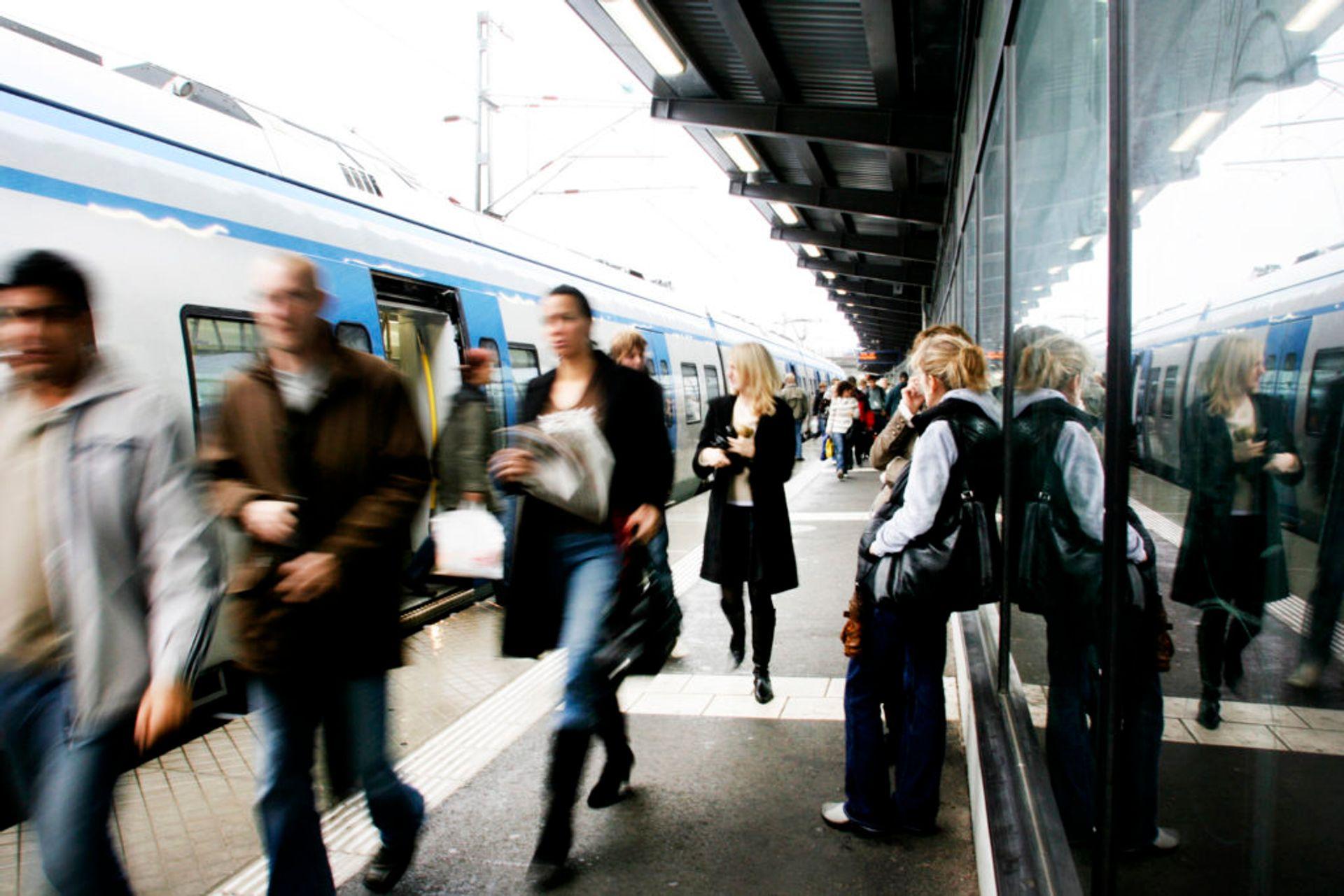 Commuters leaving a train.