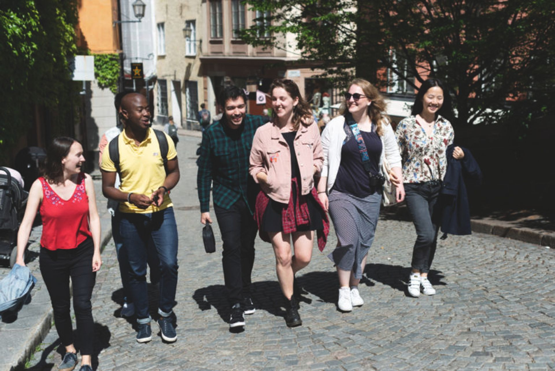 A group of students walking in Stockholm's Old Town.