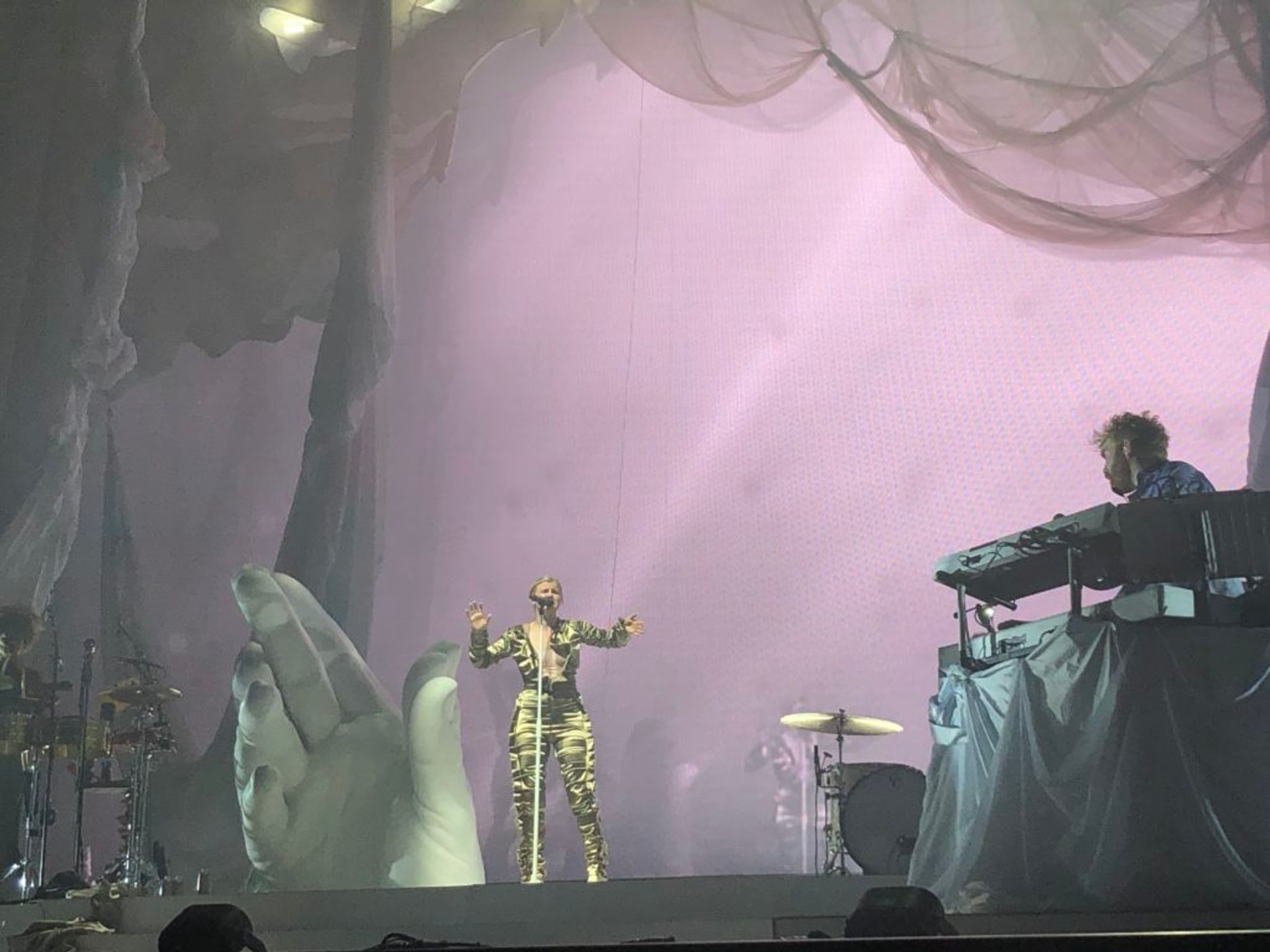 Robyn singing live on stage.