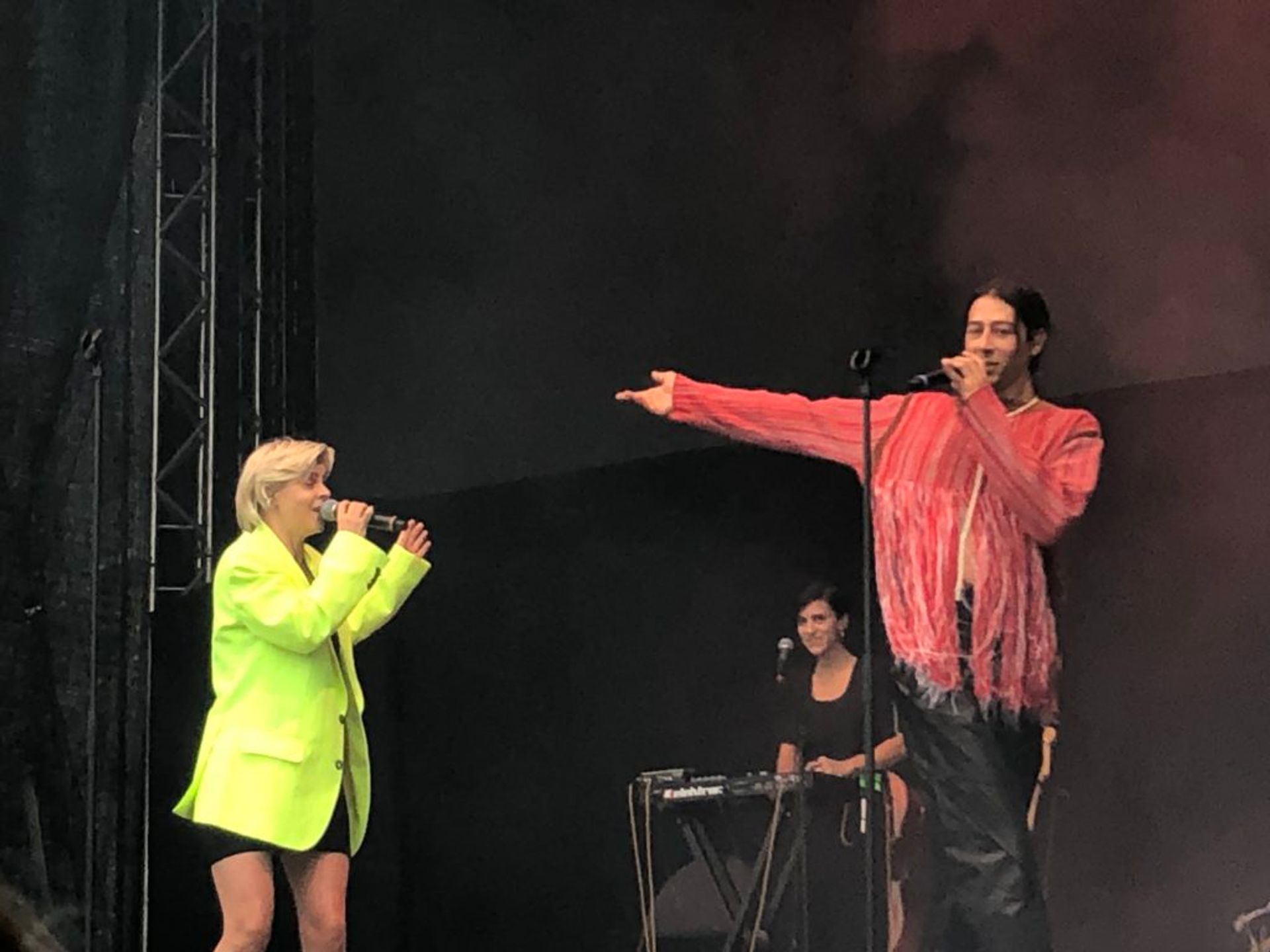 Kindness and Robyn singing together on stage.