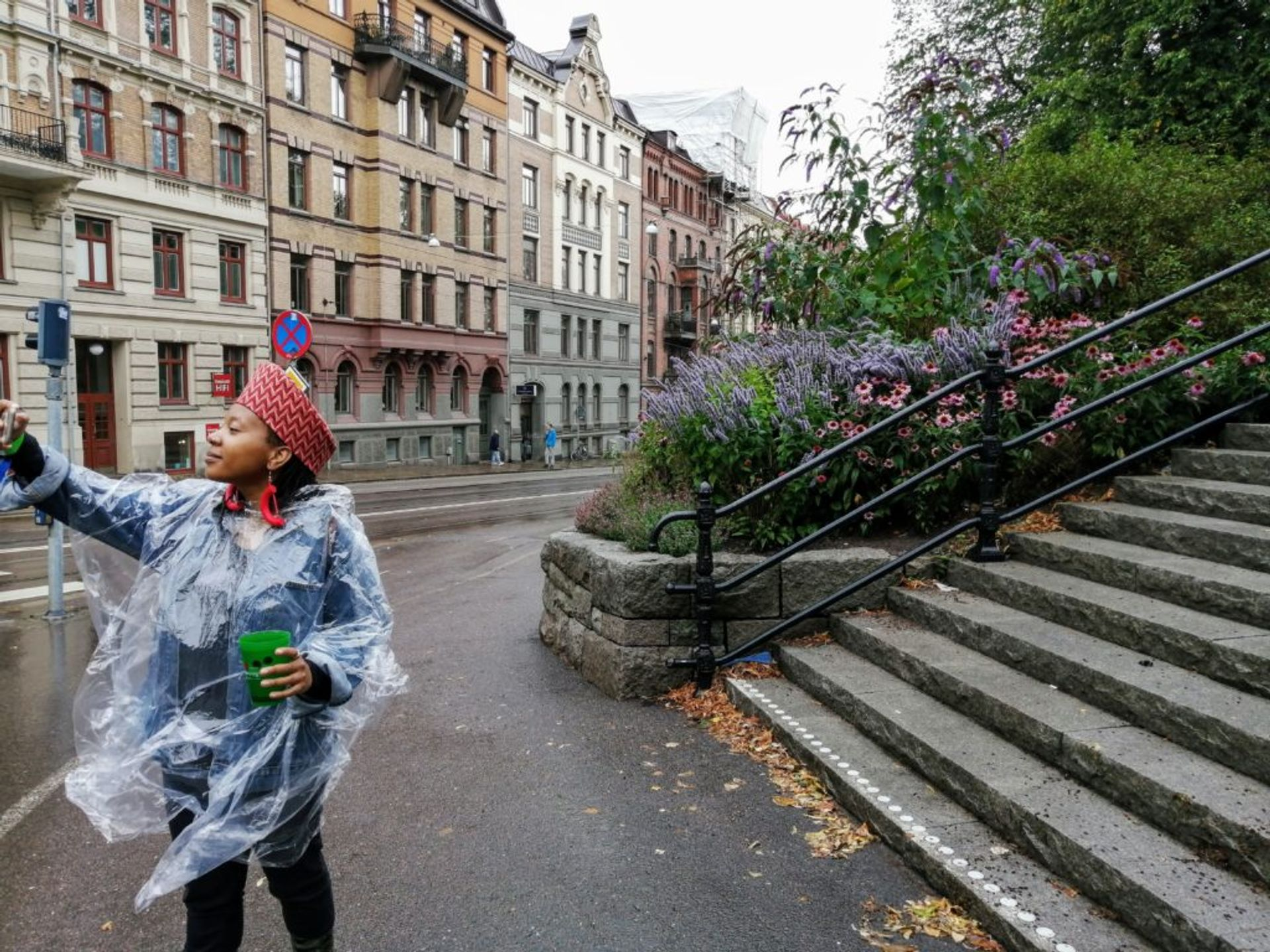 Nthupula taking a rainy selfie in front of a park in Gothenburg