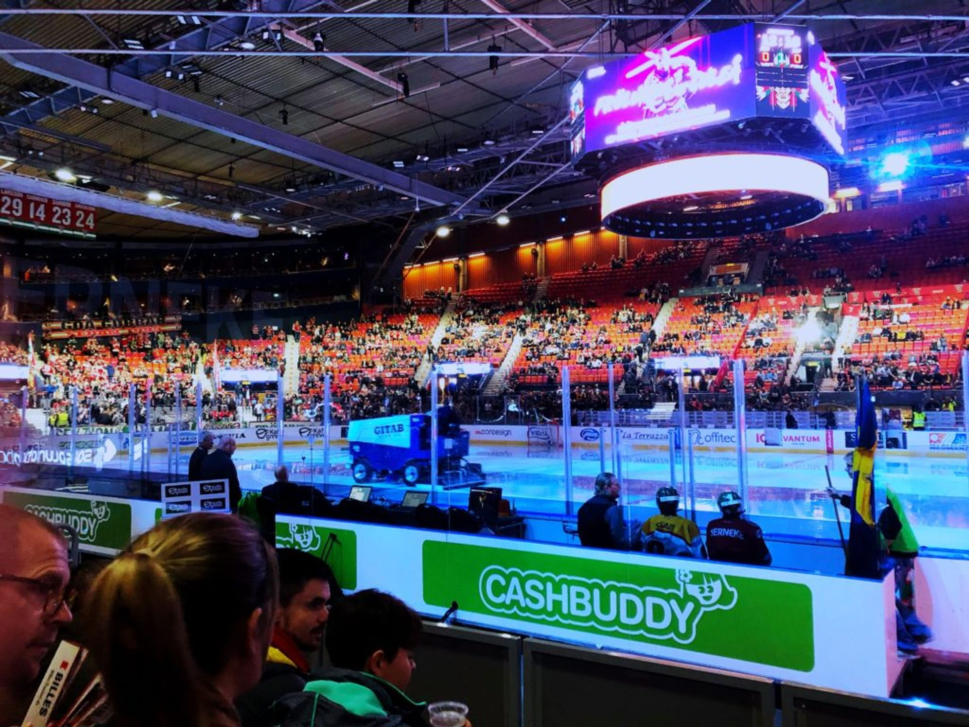 An ice hockey arena filled with people.