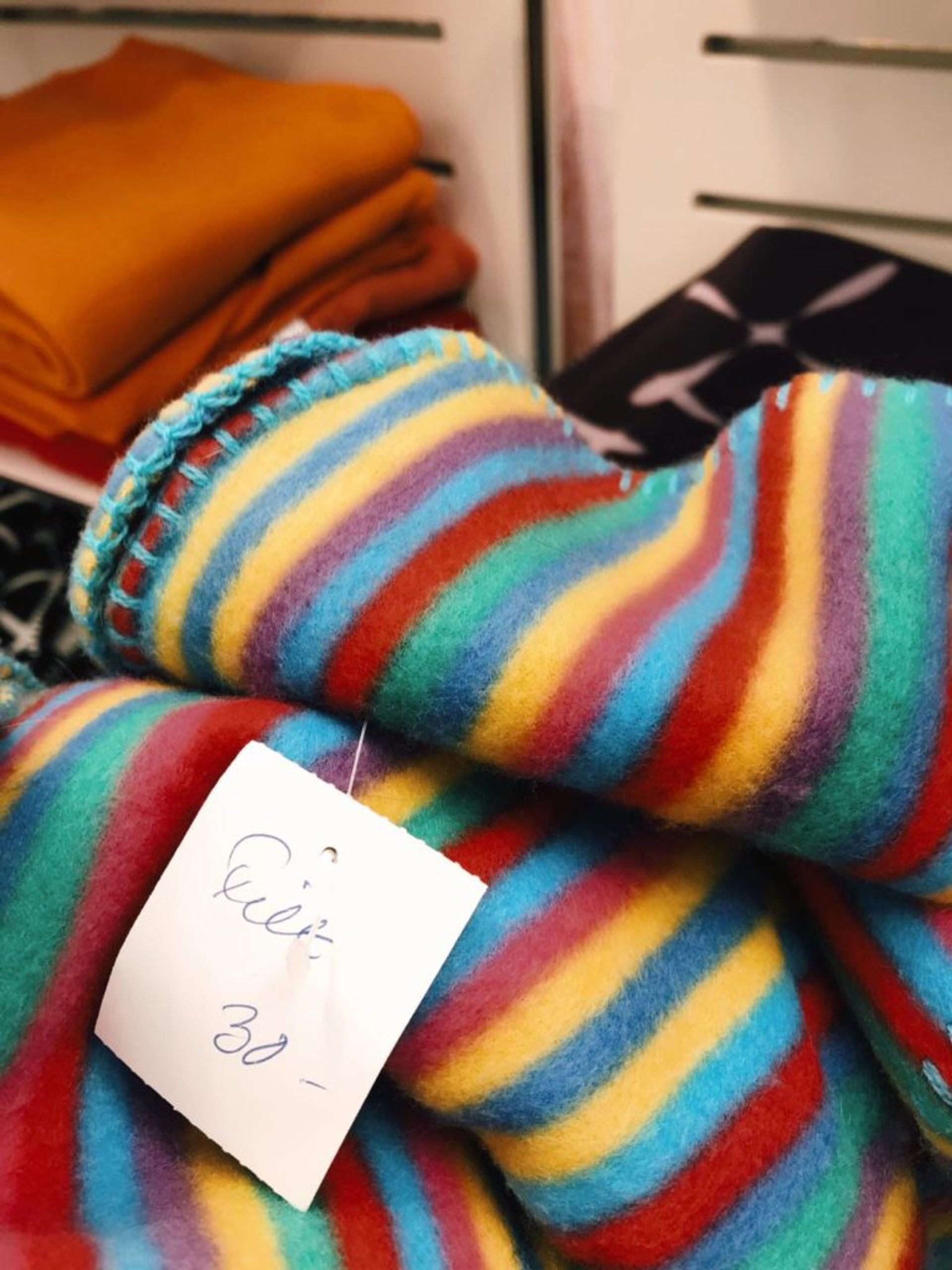 Close-up of a rainbow-coloured blanket.
