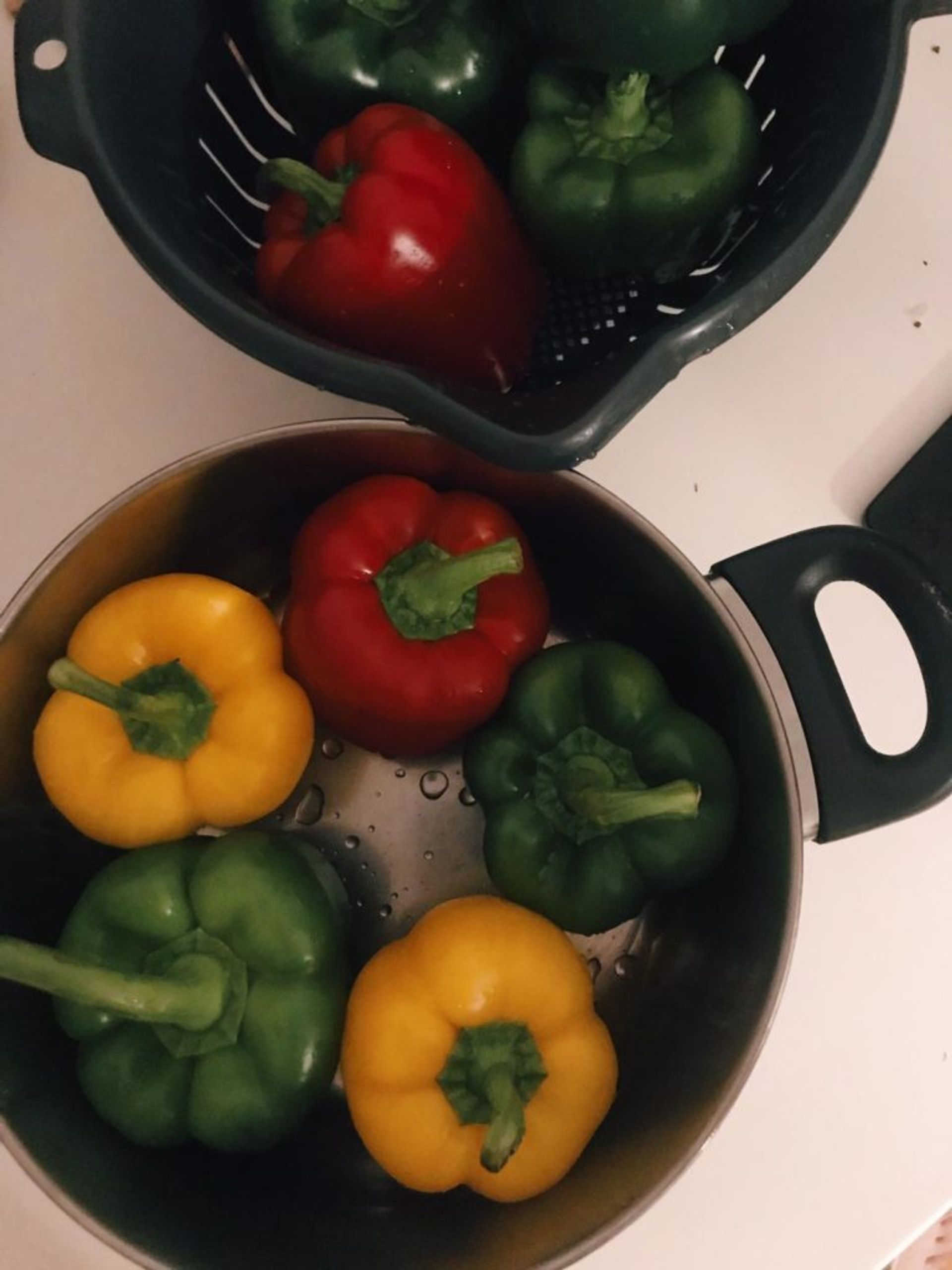 Close-up of peppers cooking in a pan.