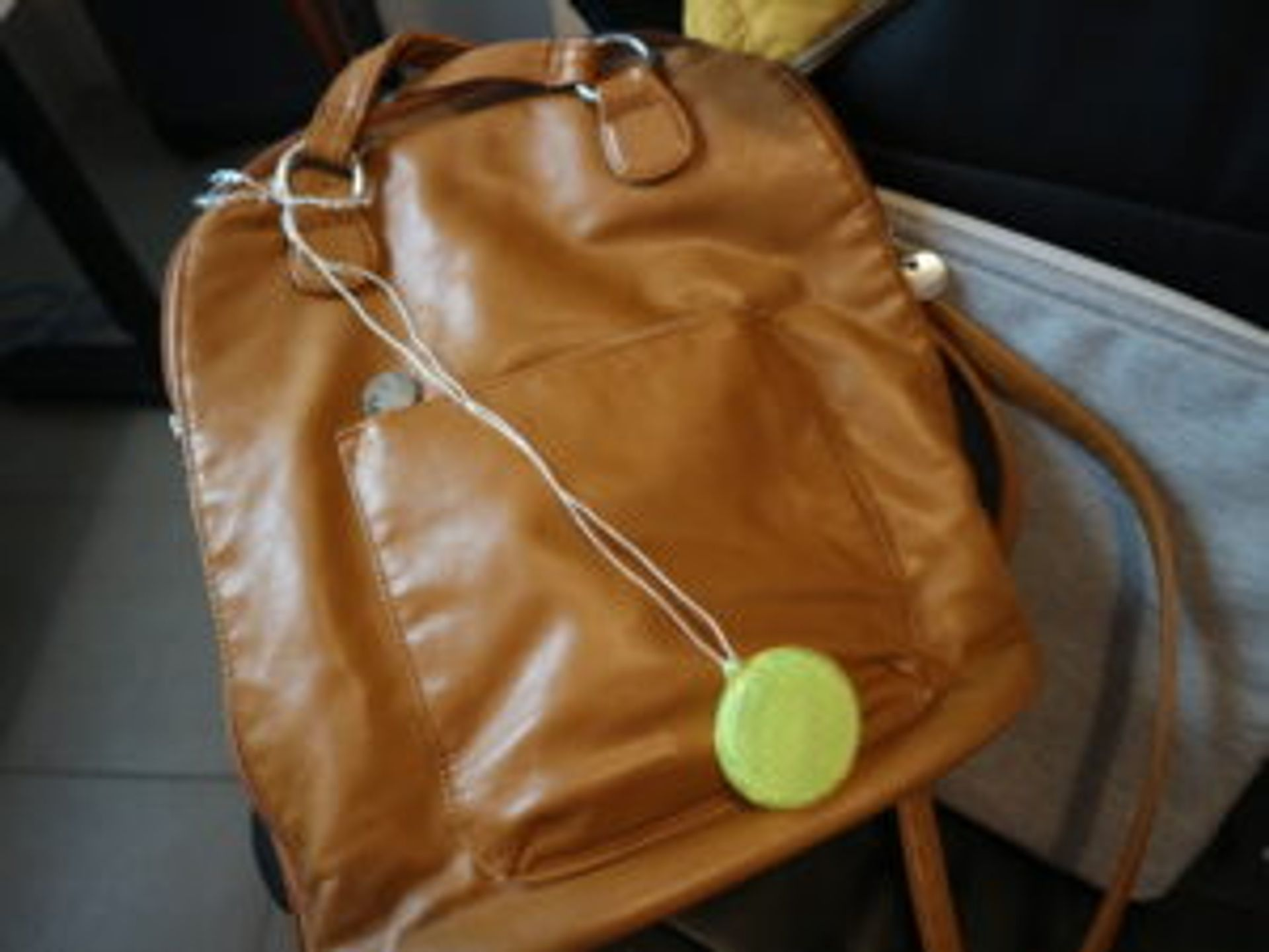 Close-up of a reflector attached to a bag.