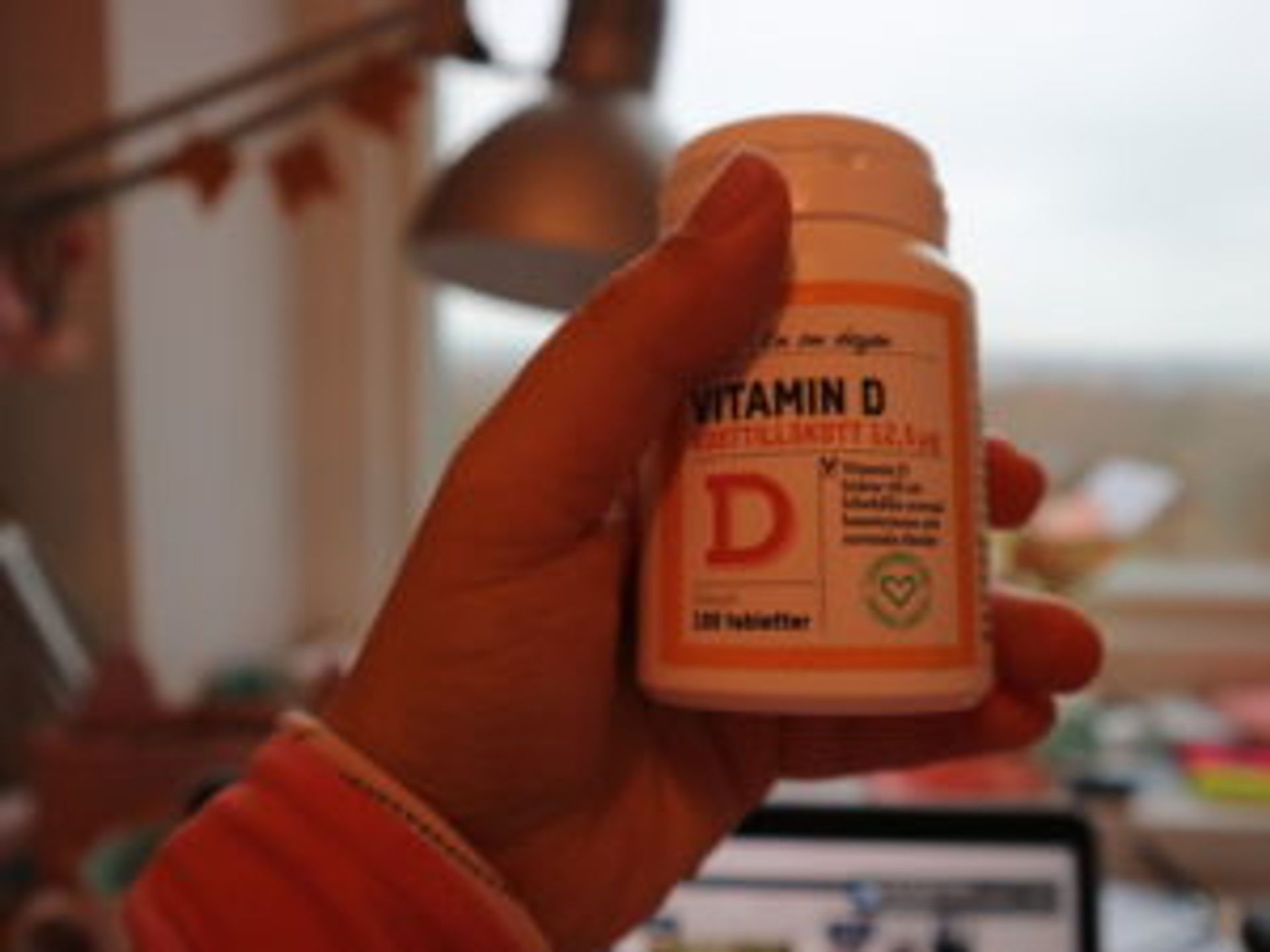 Close-up of a bottle of Vitamin D supplements.