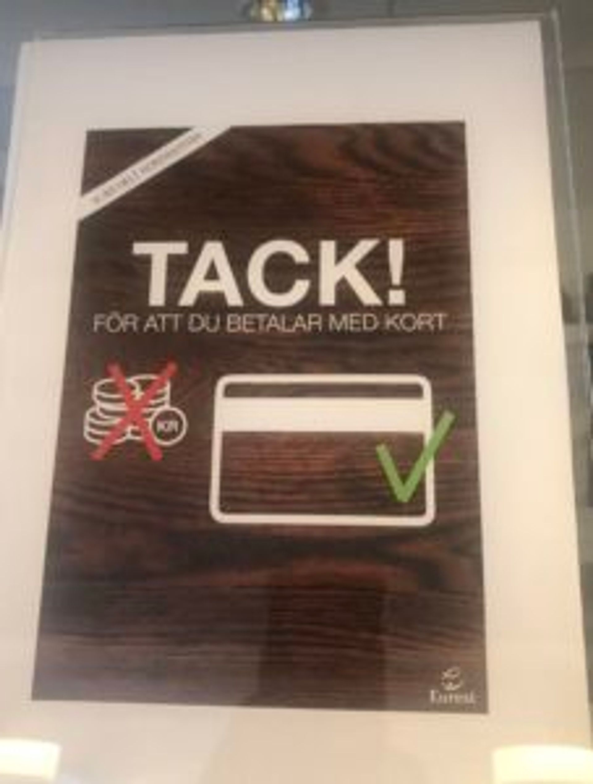 Sign in a store that reads (in Sweden), 'Thanks for paying by card'.