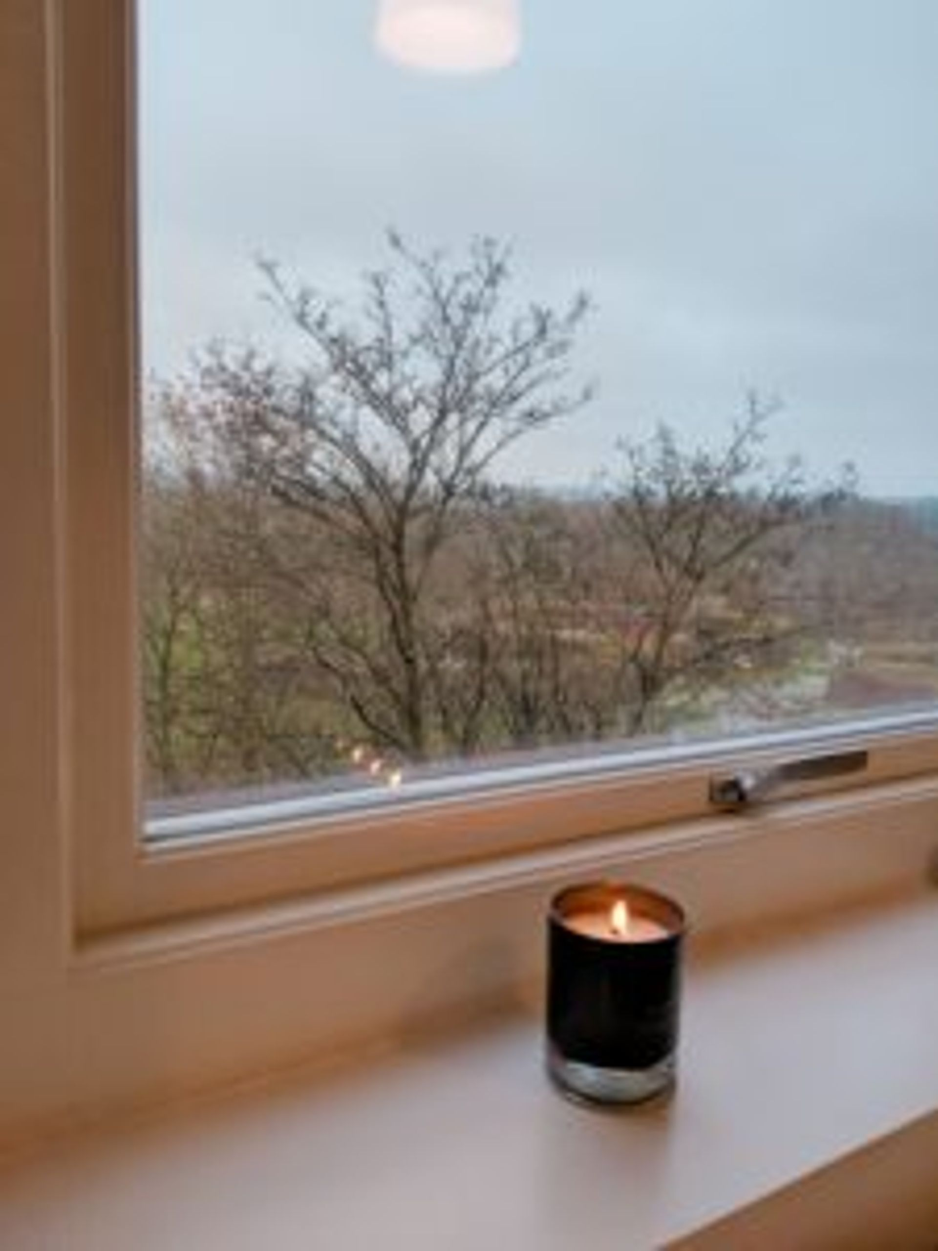 Close-up of a candle on a windowsill.