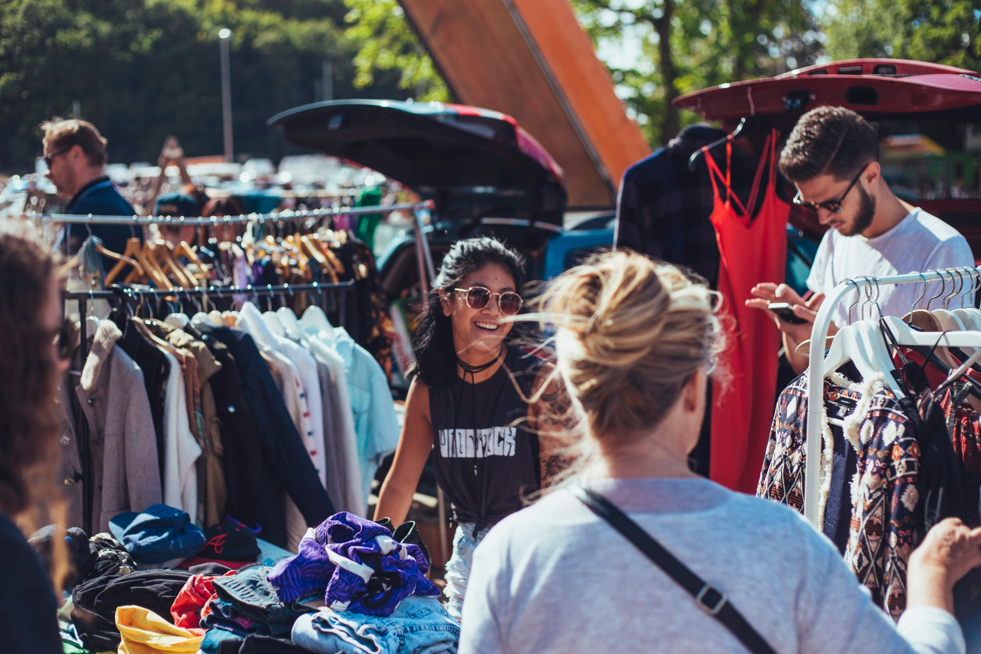 People shopping in an outdoors flea market.