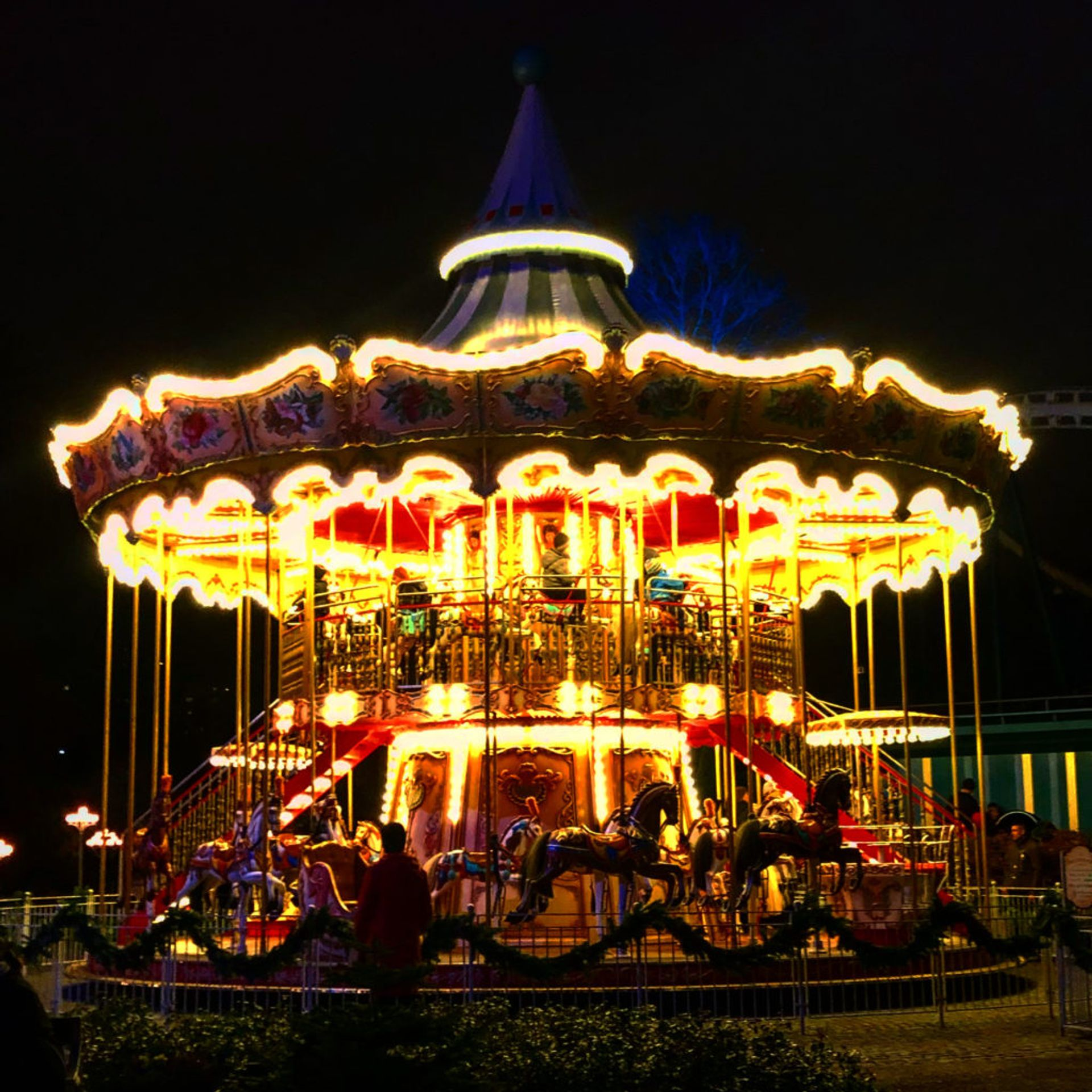A carousel lit up at night.