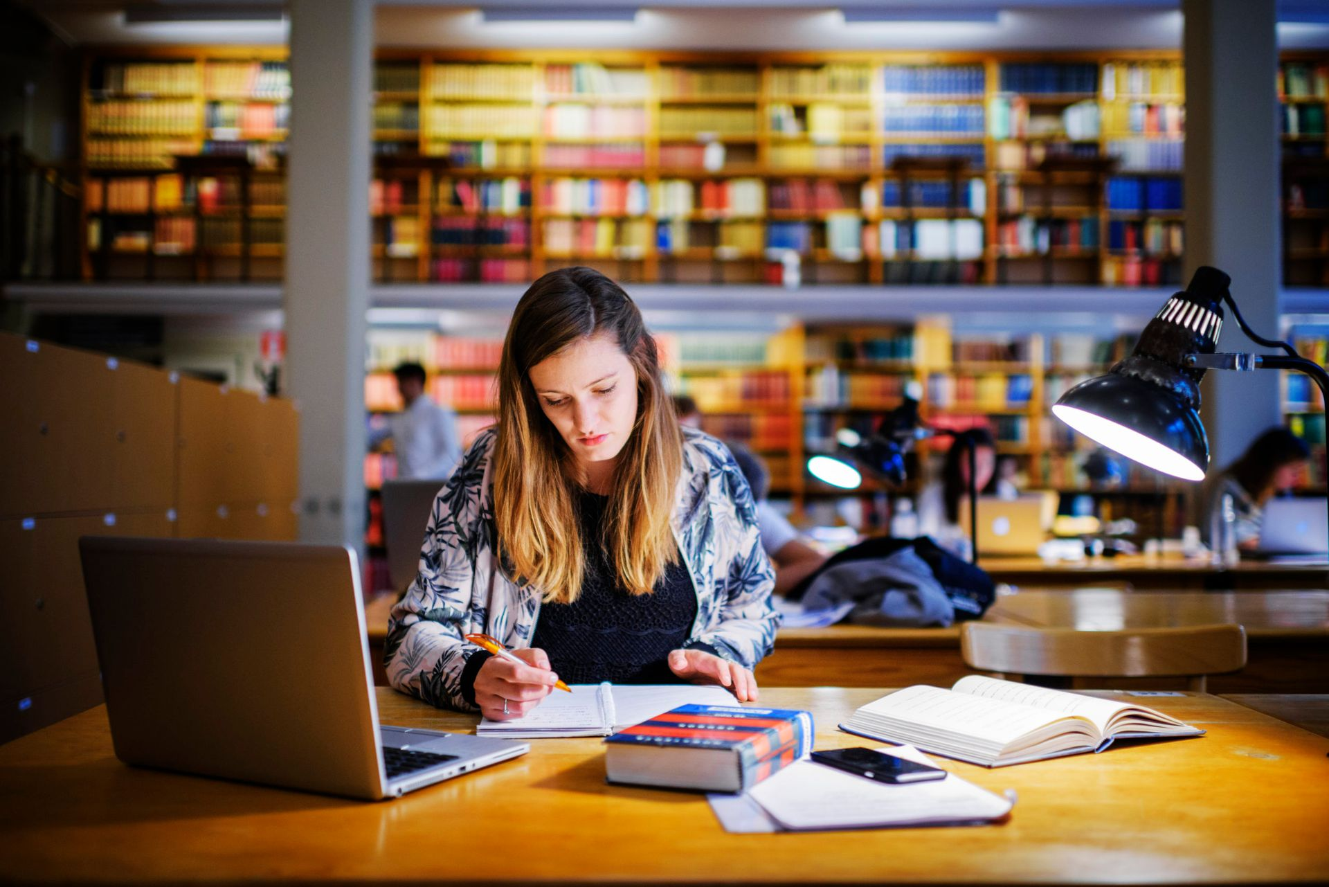 Person studying in a university library.