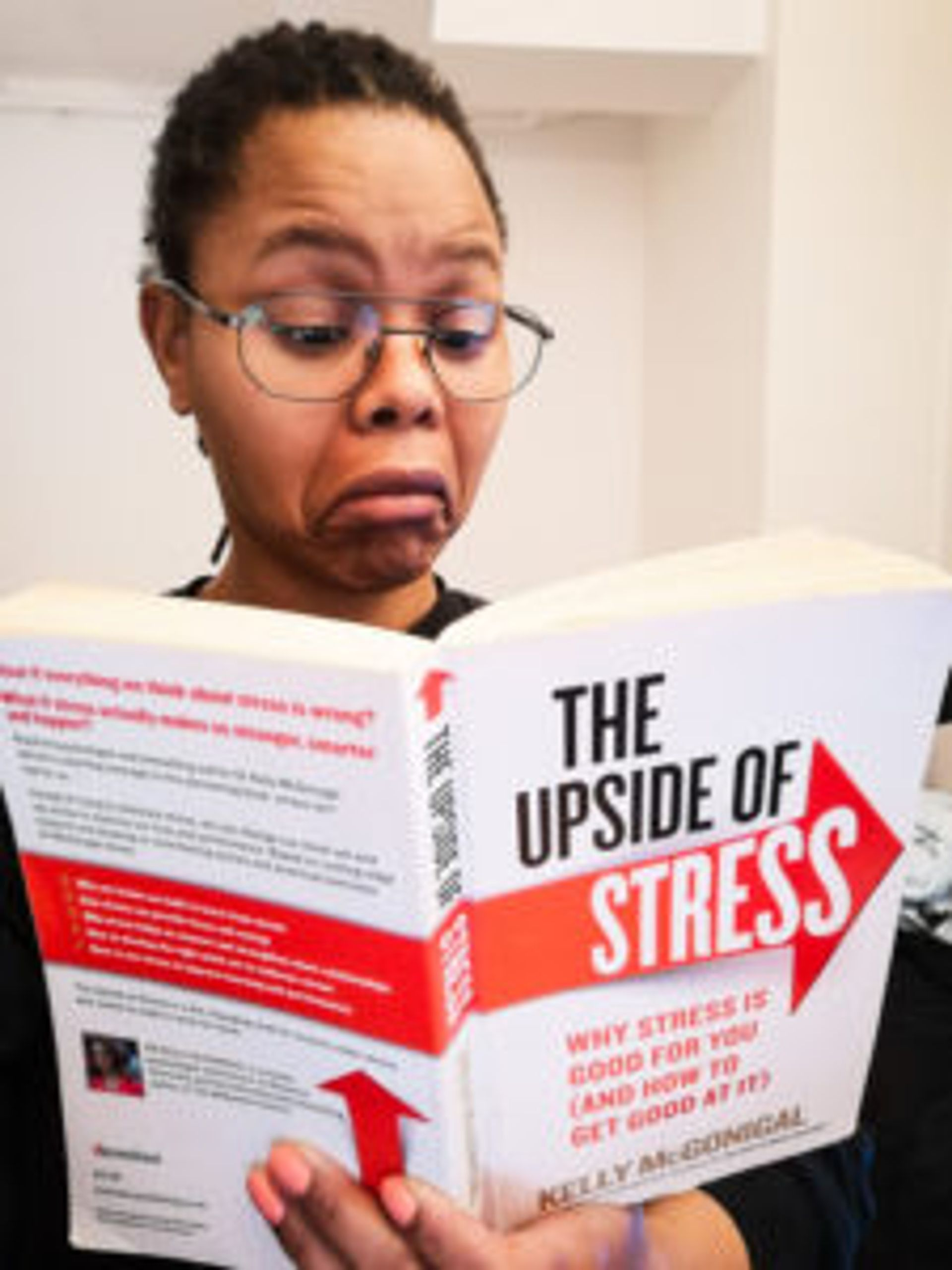 Lusanda reading the book, 'The upside of stress'.