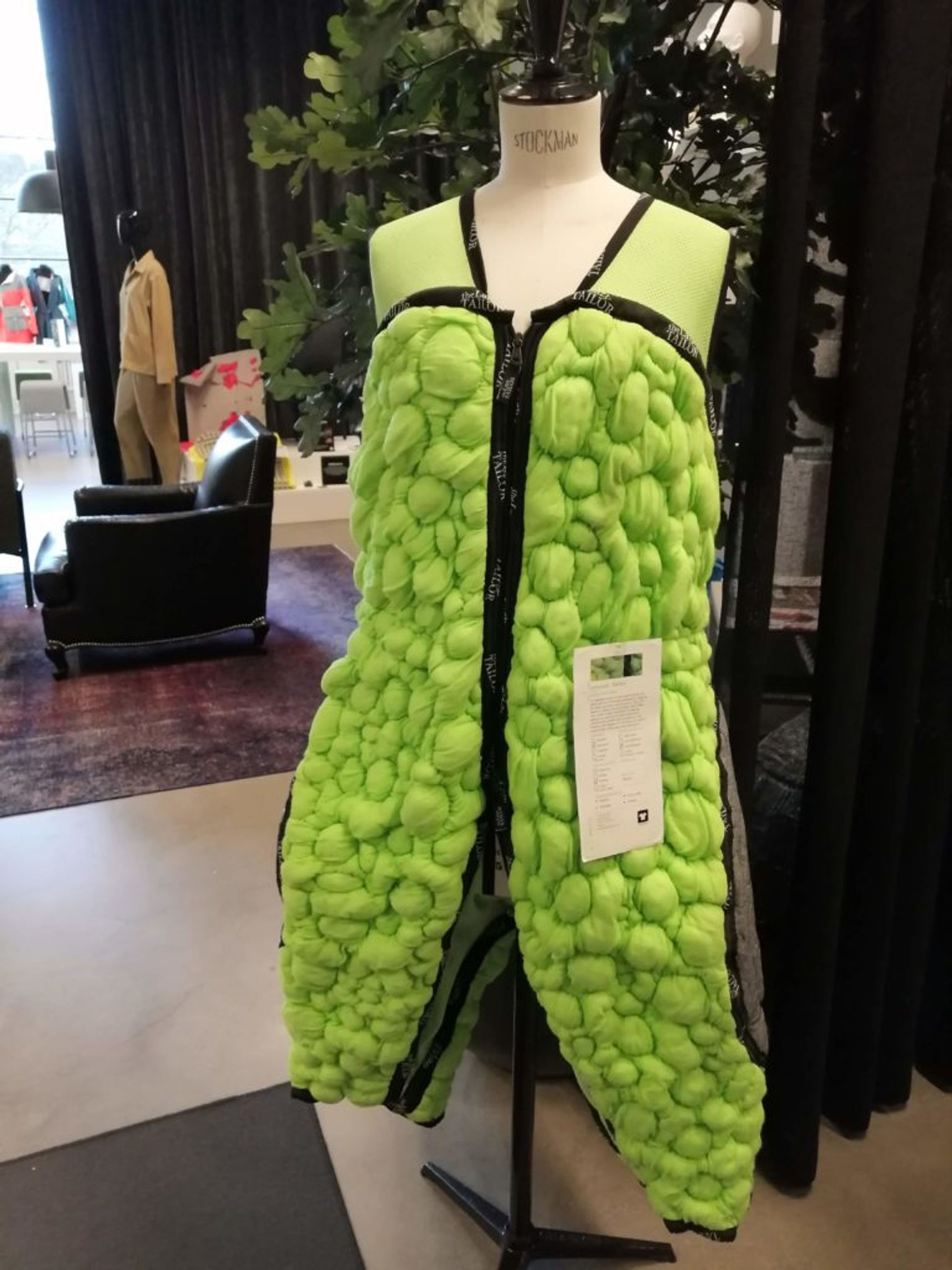 A green, knitted bodysuit in a 3D.