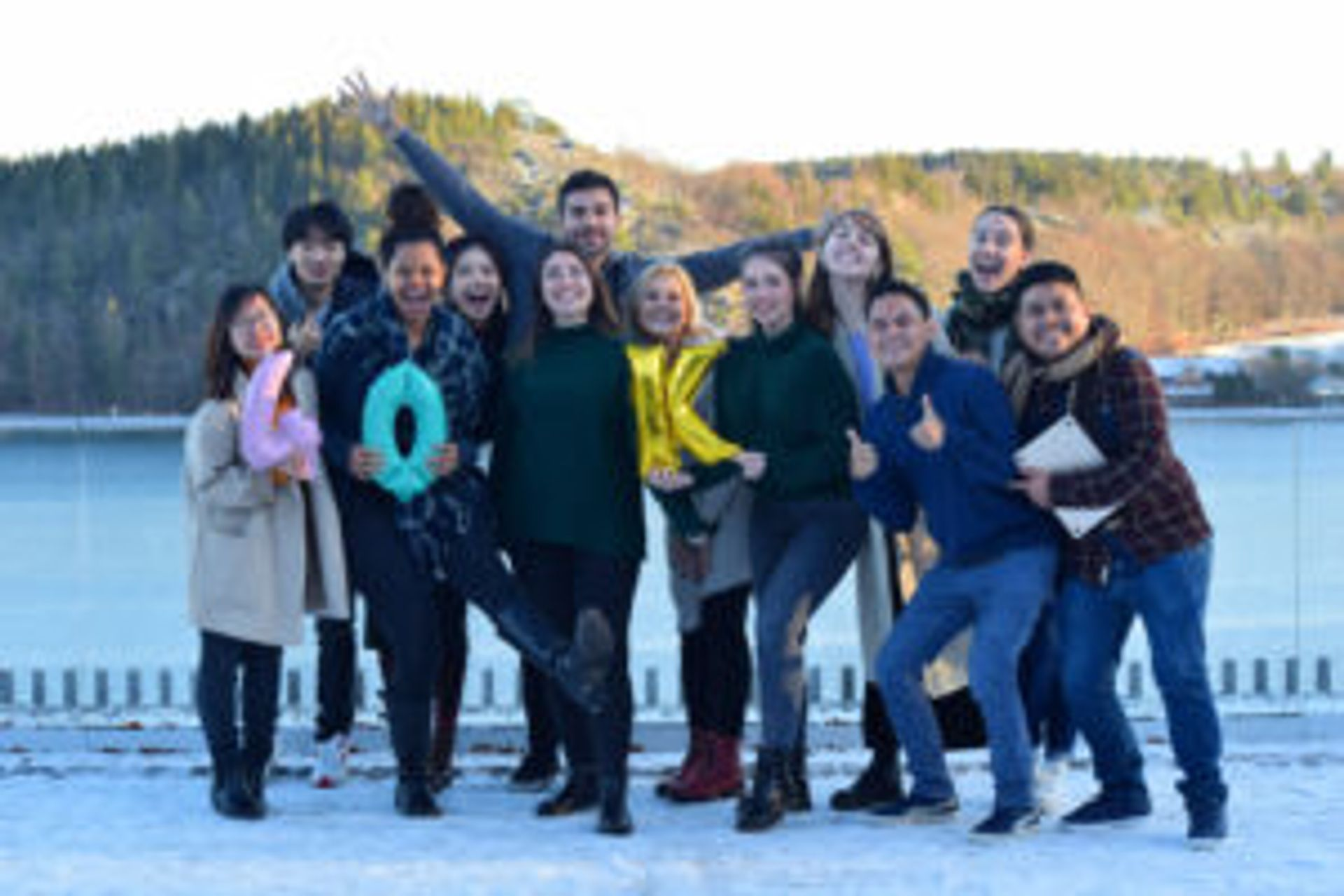 The group of Study in Sweden digital ambassadors standing together in front of a lake.