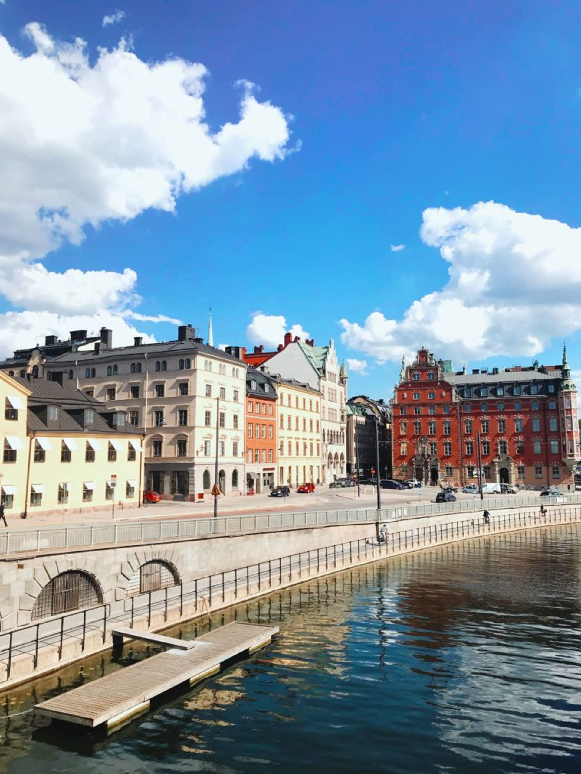 Red, white and cream coloured buildings in central Stockholm.