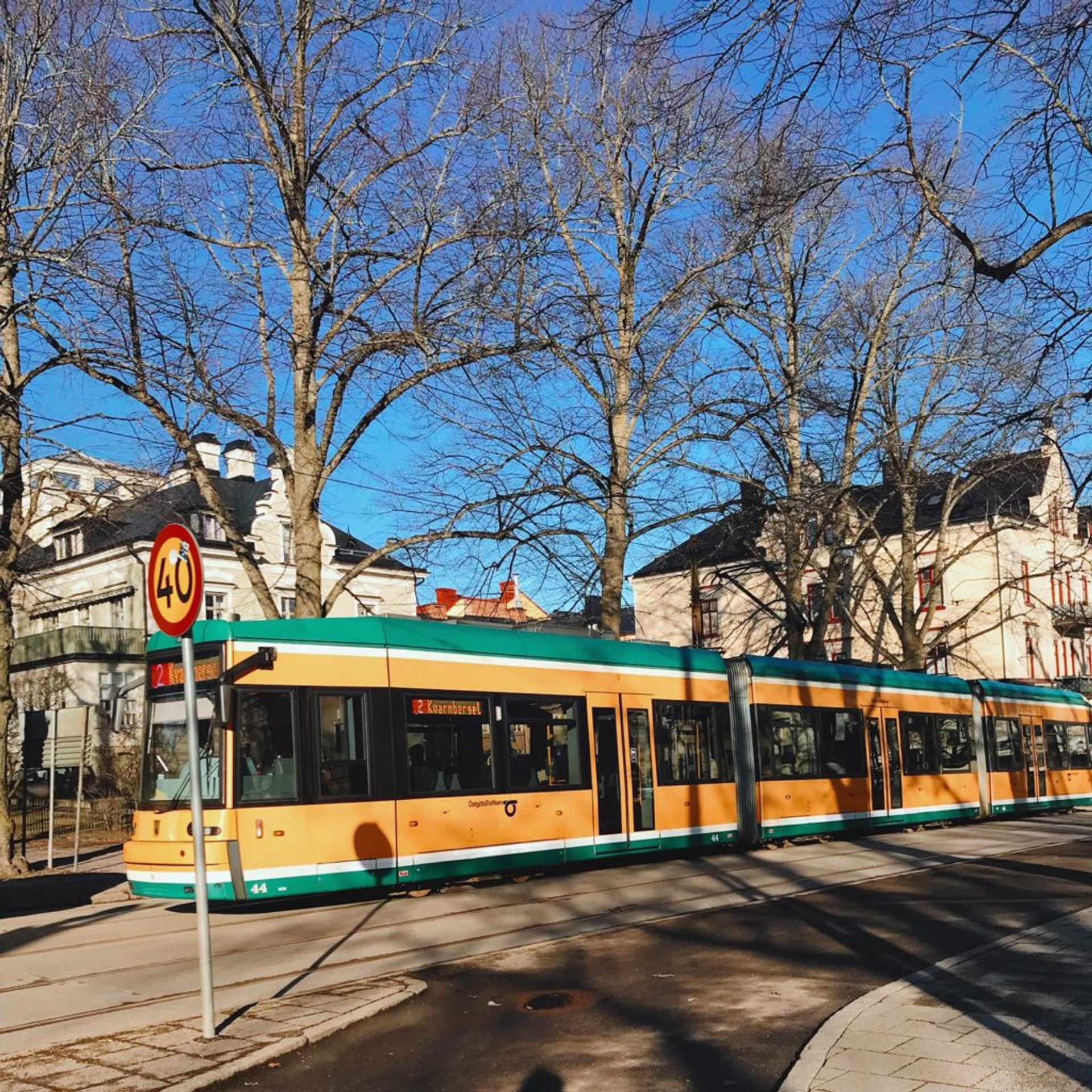 Yellow and green tram.