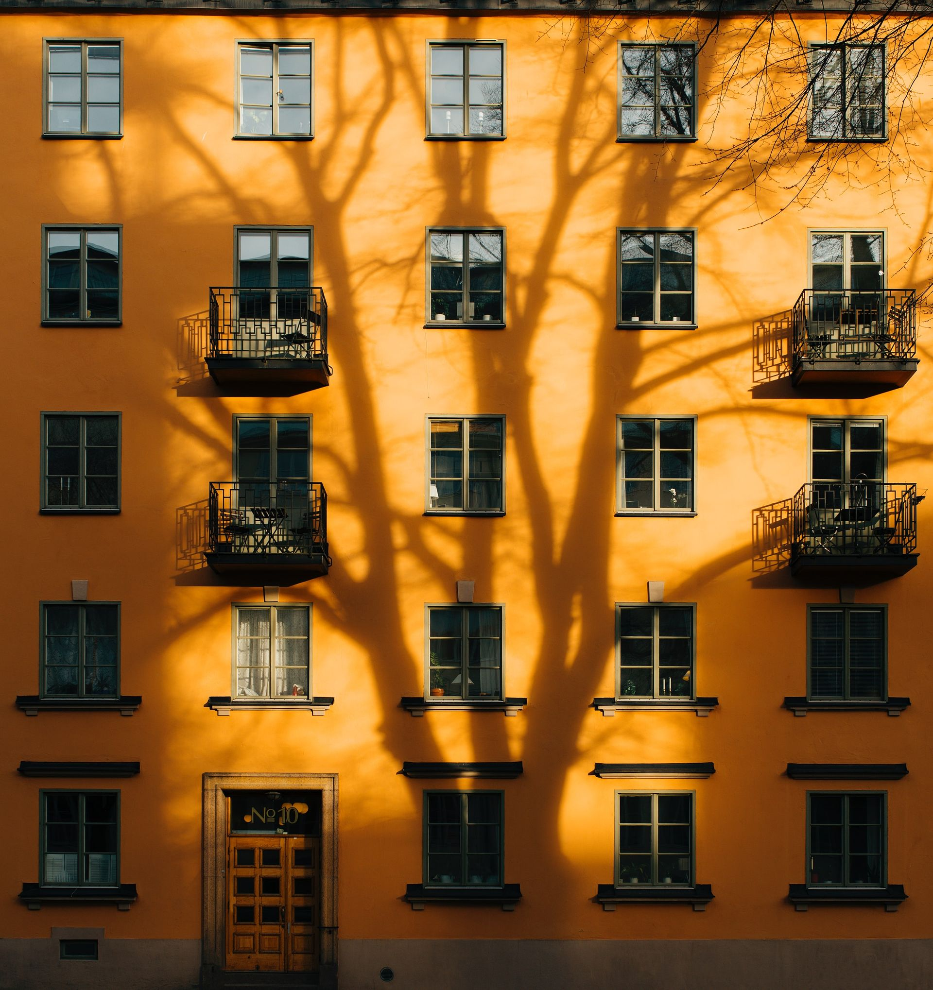 A yellow residential building.