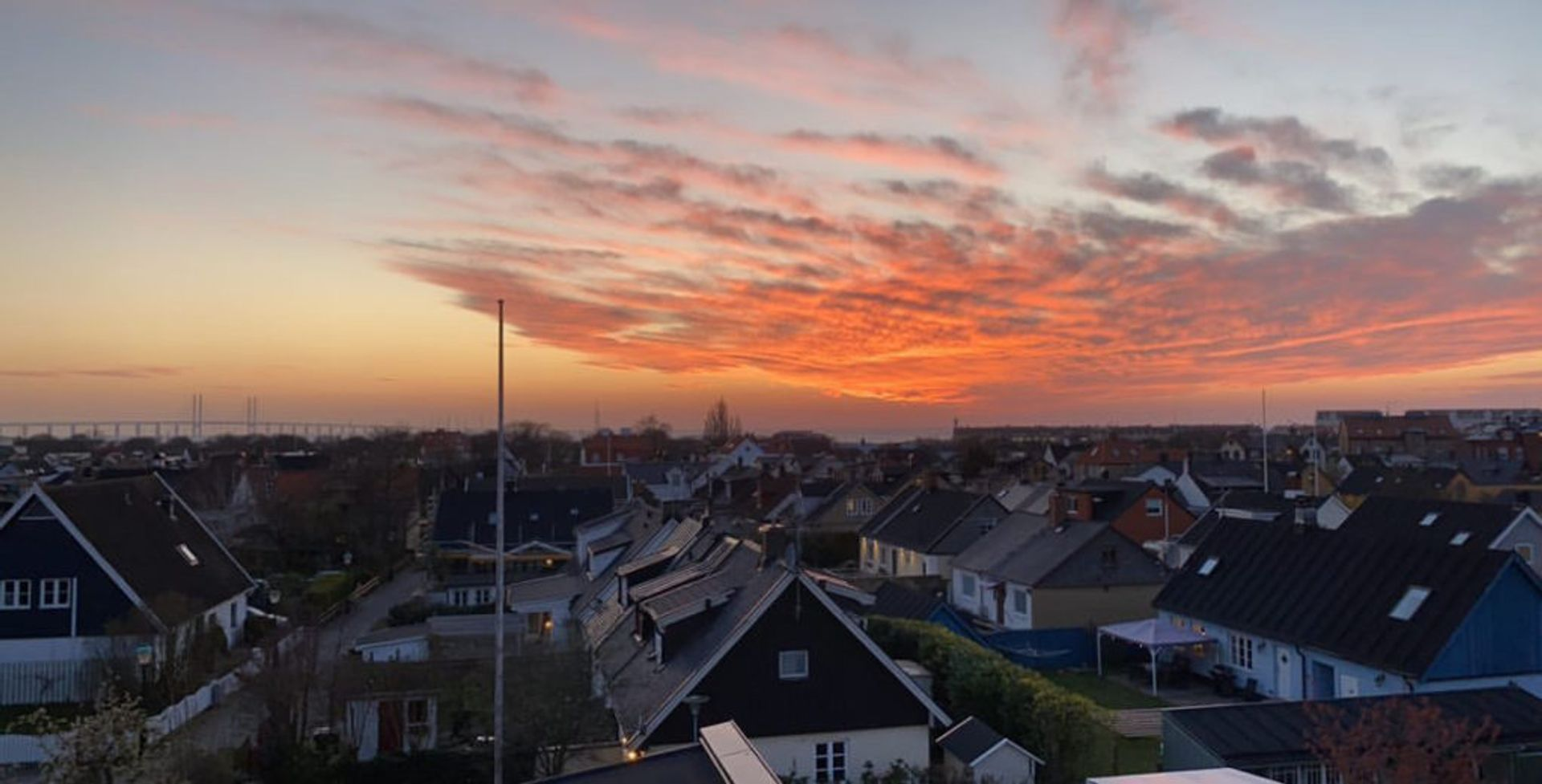 Sunset over residential houses in Malmö.