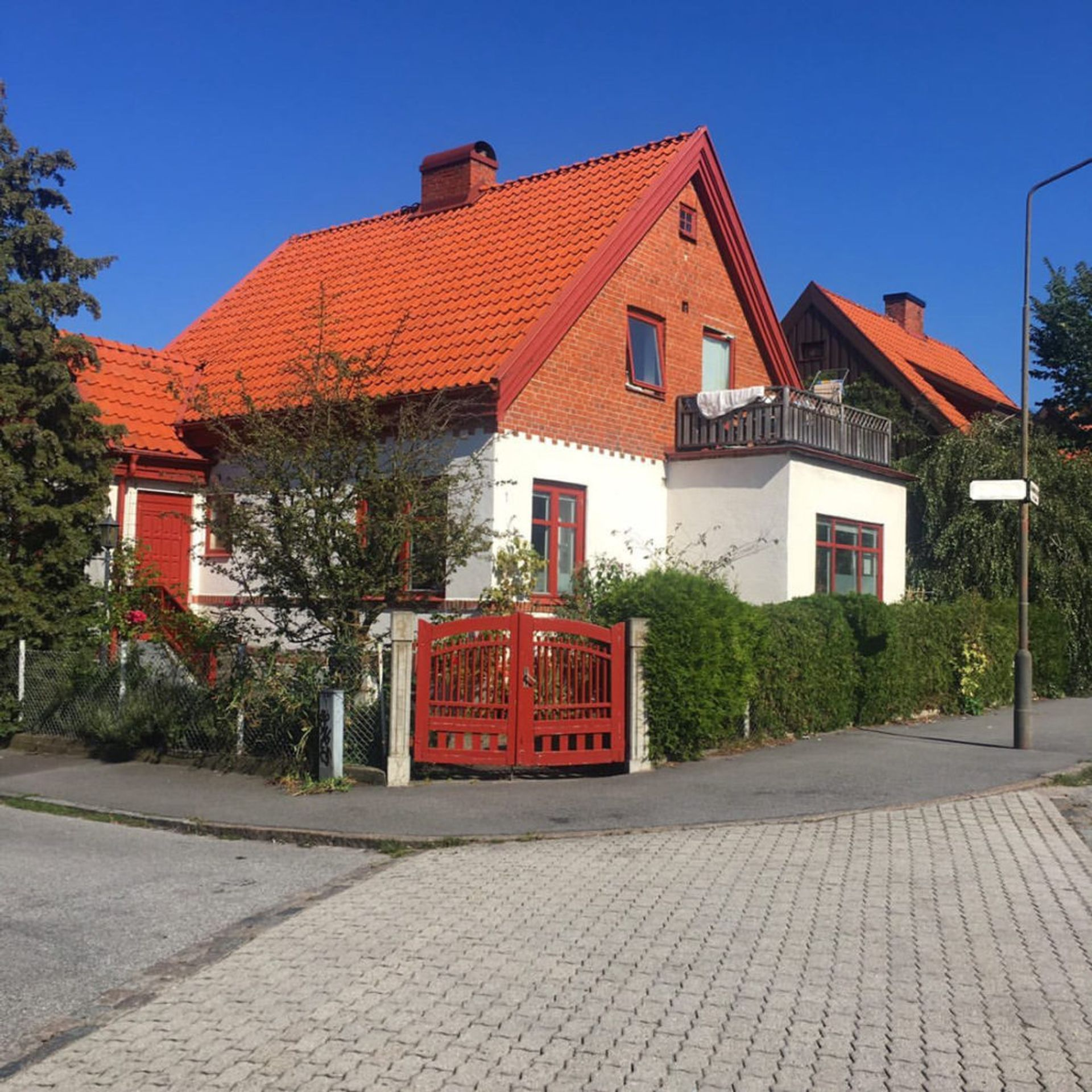 A white and red brick residential house in Malmö.