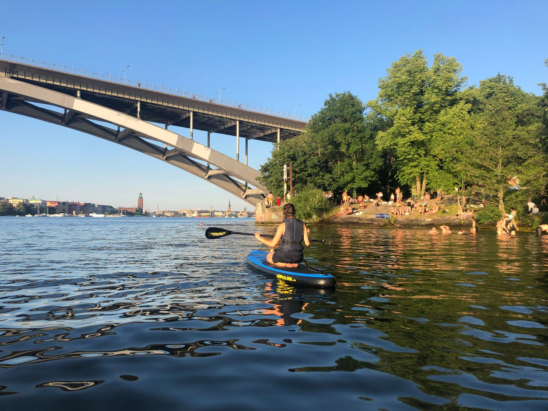 A person paddleboarding in the sea close to the centre of Stockholm.