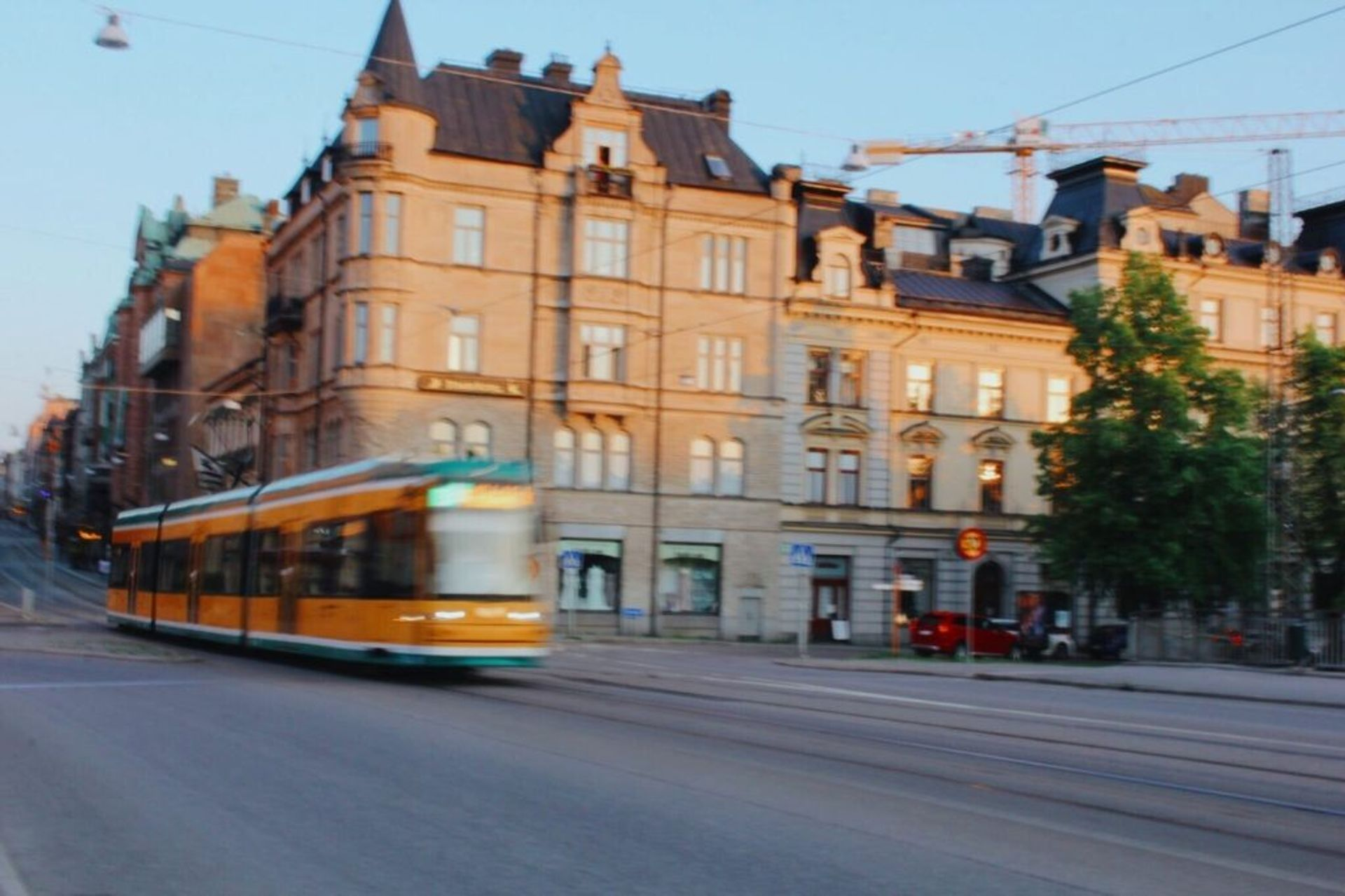 A yellow and green tram.